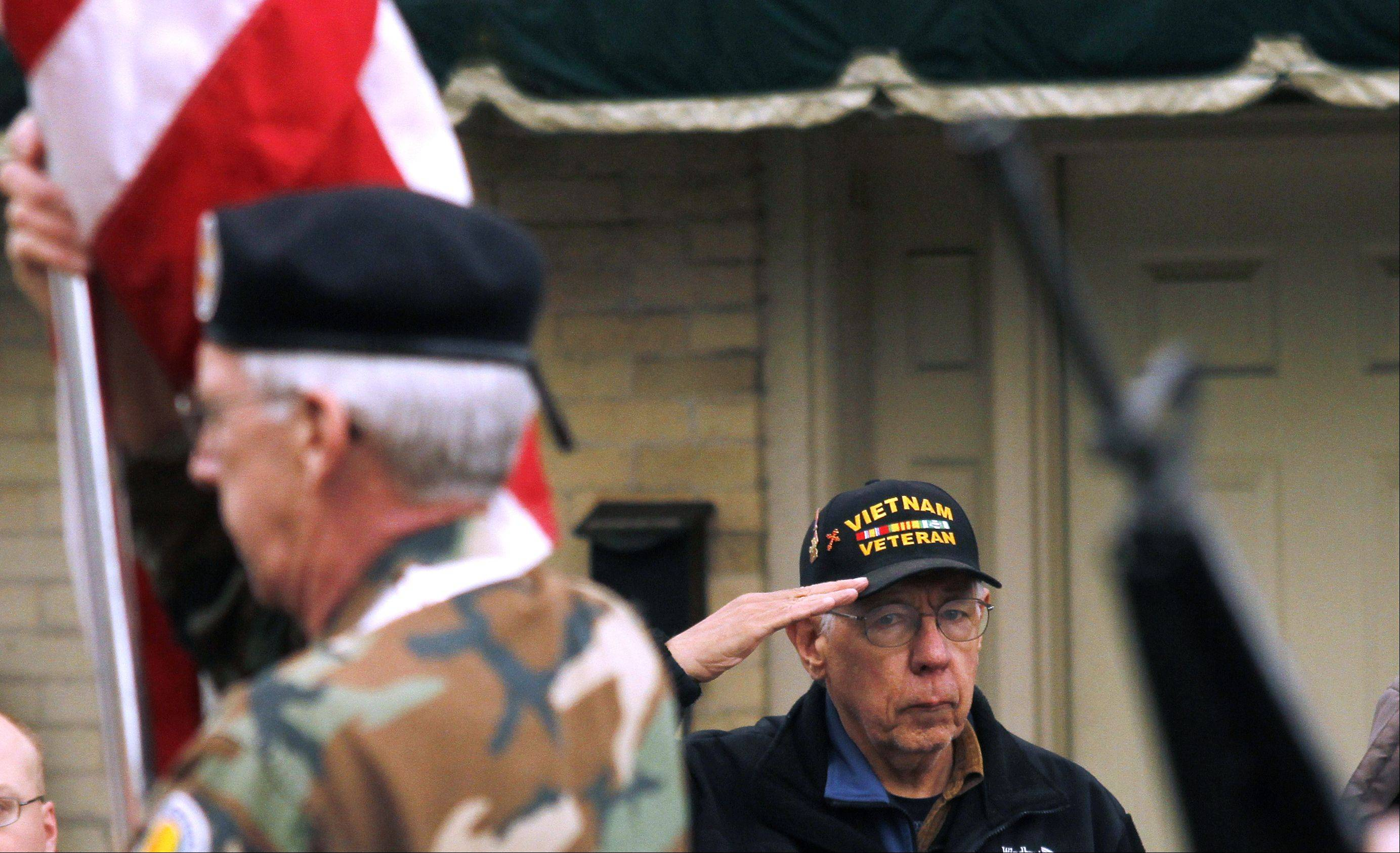 Vietnam War Veteran Irv Schroeder of West Bend salutes the American flag during the Memorial Day parade in West Bend on Monday, May 27, 2013.