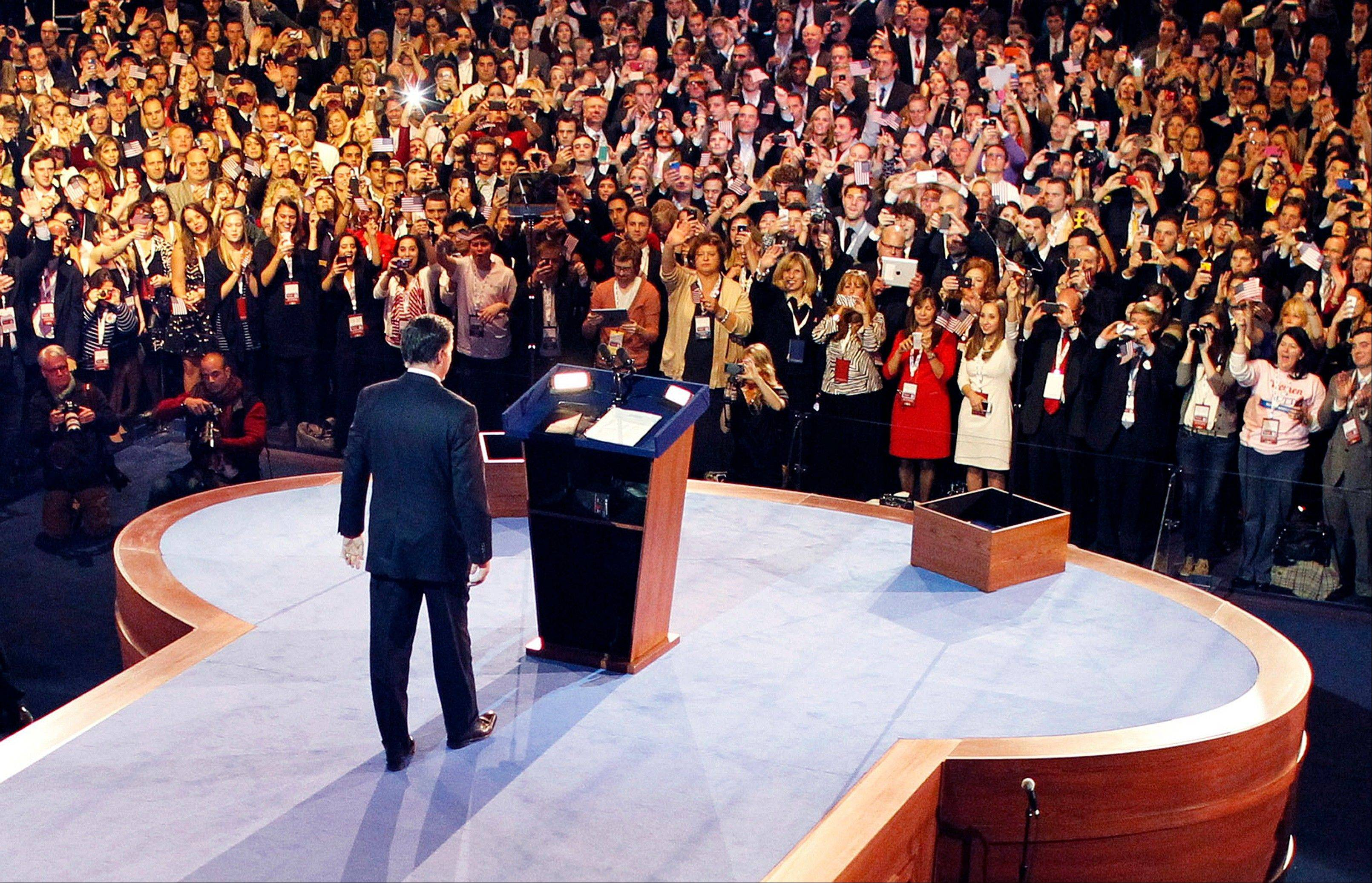 "In this Nov. 7, 2012, file photo Republican presidential candidate, former Massachusetts Gov. Mitt Romney, arrives to give his presidential election night concession speech in Boston. A 97-page election post-mortem, commissioned by the Republican Party after Romney's loss last fall, said the GOP ""is increasingly marginalizing itself, and unless changes are made, it will be increasingly difficult for Republicans to win another presidential election in the near future."""