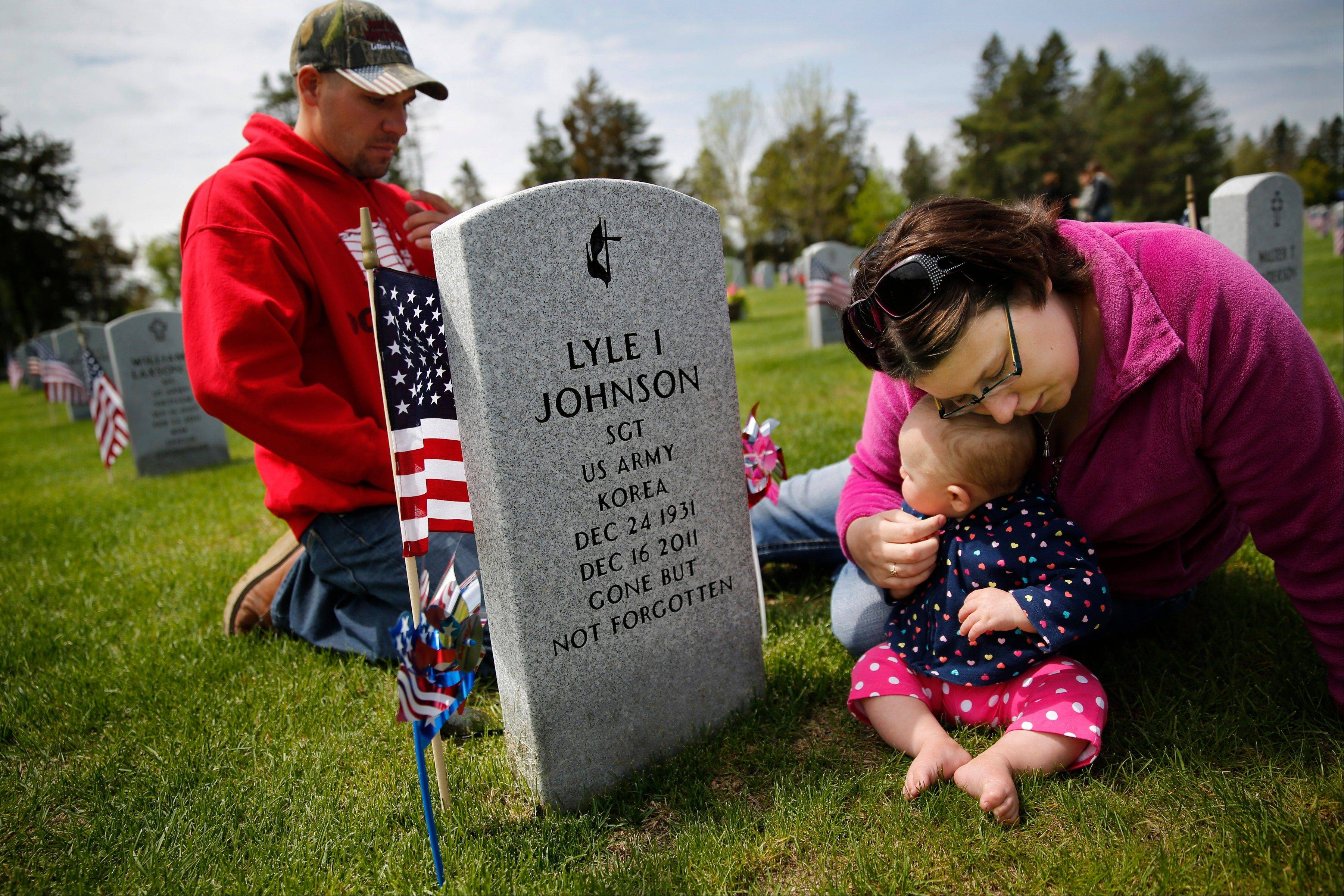 Americans planned to gather at cemeteries, memorials and monuments nationwide to honor fallen military service members on Memorial Day, at a time when combat in Afghanistan approaches 12 years and the ranks of World War II veterans dwindles.