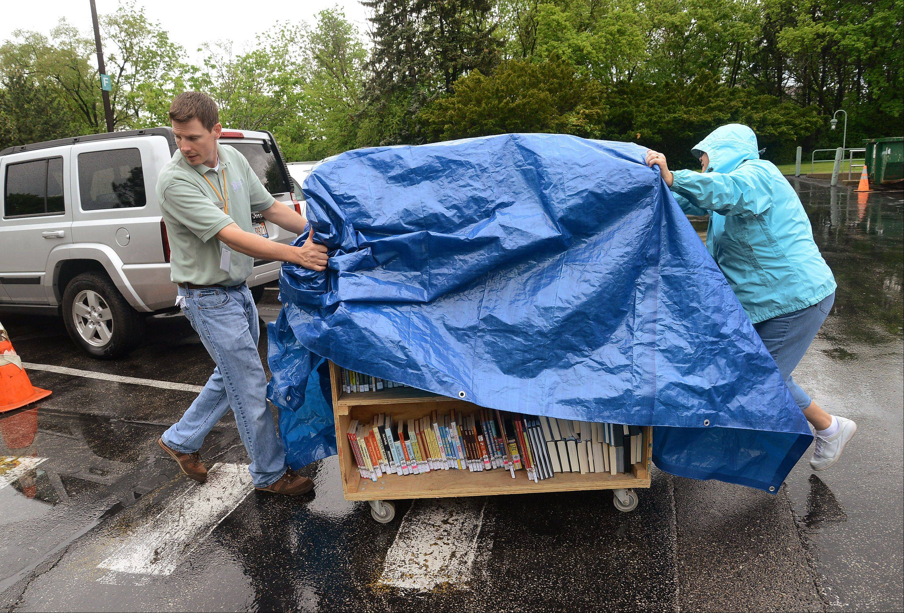 Head of Circulation Stephen Territo and Circulation Coordinator Vivien Starr move a cart full of books and DVDs from the library annex back to the newly renovated Vernon Area Library. Roughly 20,000 items needed to be moved after a $1.3 million renovation.