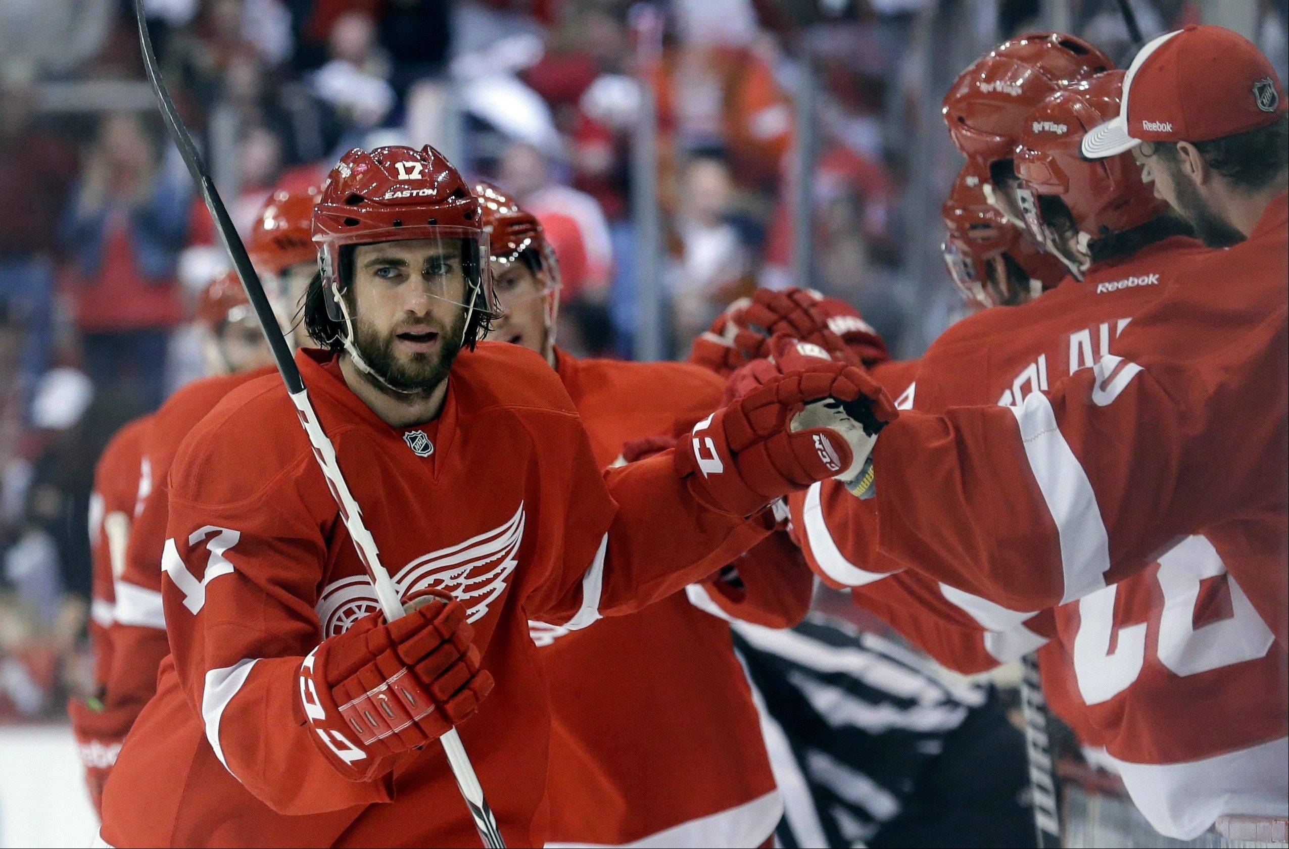Detroit Red Wings right wing Patrick Eaves (17) celebrates scoring a goal against the Chicago Blackhawks during the first period in Game 6 of the Western Conference semifinals in the NHL hockey Stanley Cup playoffs in Detroit, Monday, May 27, 2013.