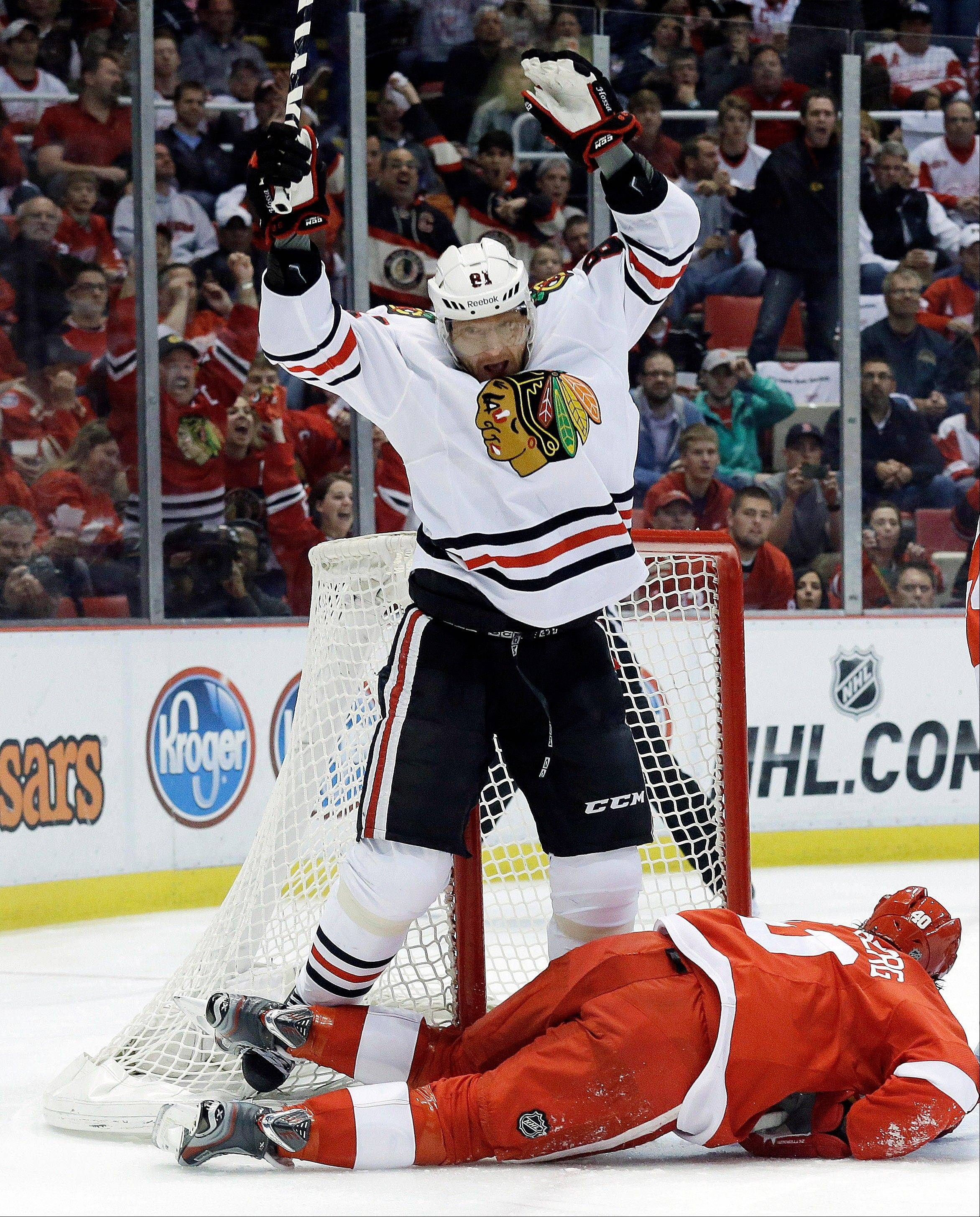 Chicago Blackhawks right wing Marian Hossa (81), of the Czech Republic, celebrates his goal against the Detroit Red Wings during the first period in Game 6 of the Western Conference semifinals in the NHL hockey Stanley Cup playoffs in Detroit, Monday, May 27, 2013.