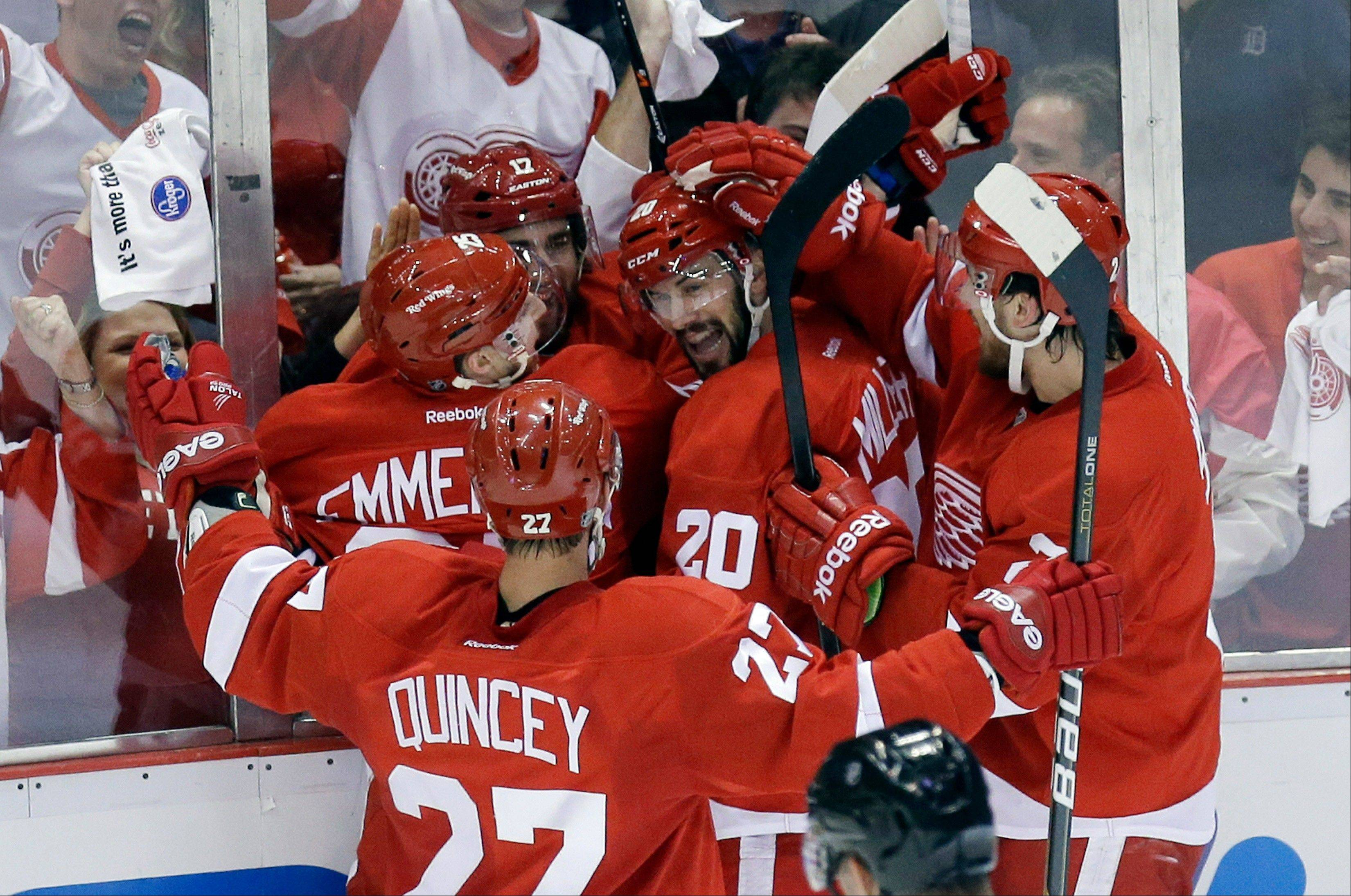 Detroit Red Wings right wing Patrick Eaves (17) celebrates his goal with teammates Cory Emmerton (25), Drew Miller (20), Kyle Quincey (27) and Brendan Smith, right, during the first period of Game 6 of the NHL hockey Stanley Cup playoffs Western Conference semifinals against the Chicago Blackhawks in Detroit, Monday, May 27, 2013.