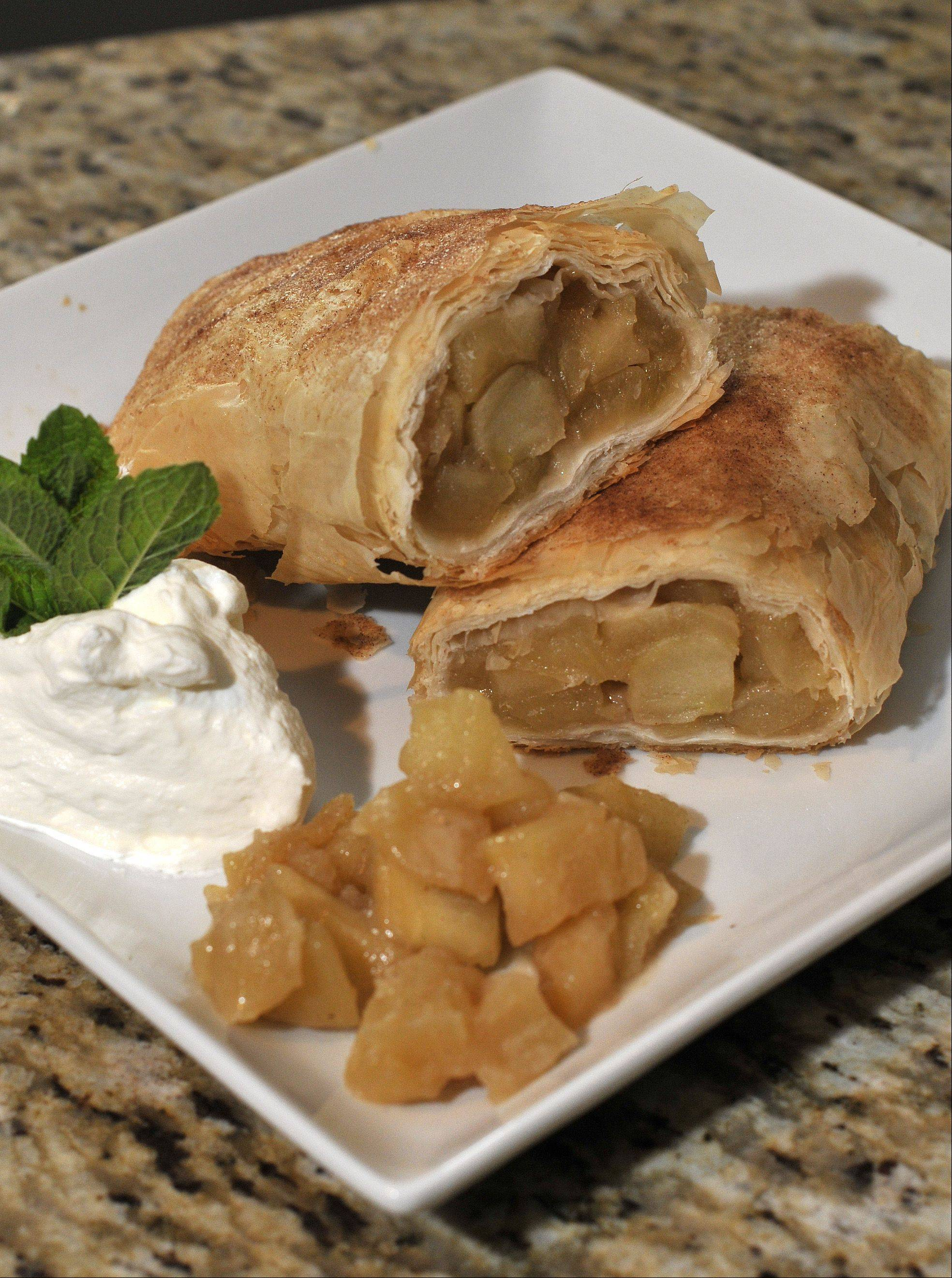 Brian Emmett of Itasca makes his own pastry for his apple strudel.