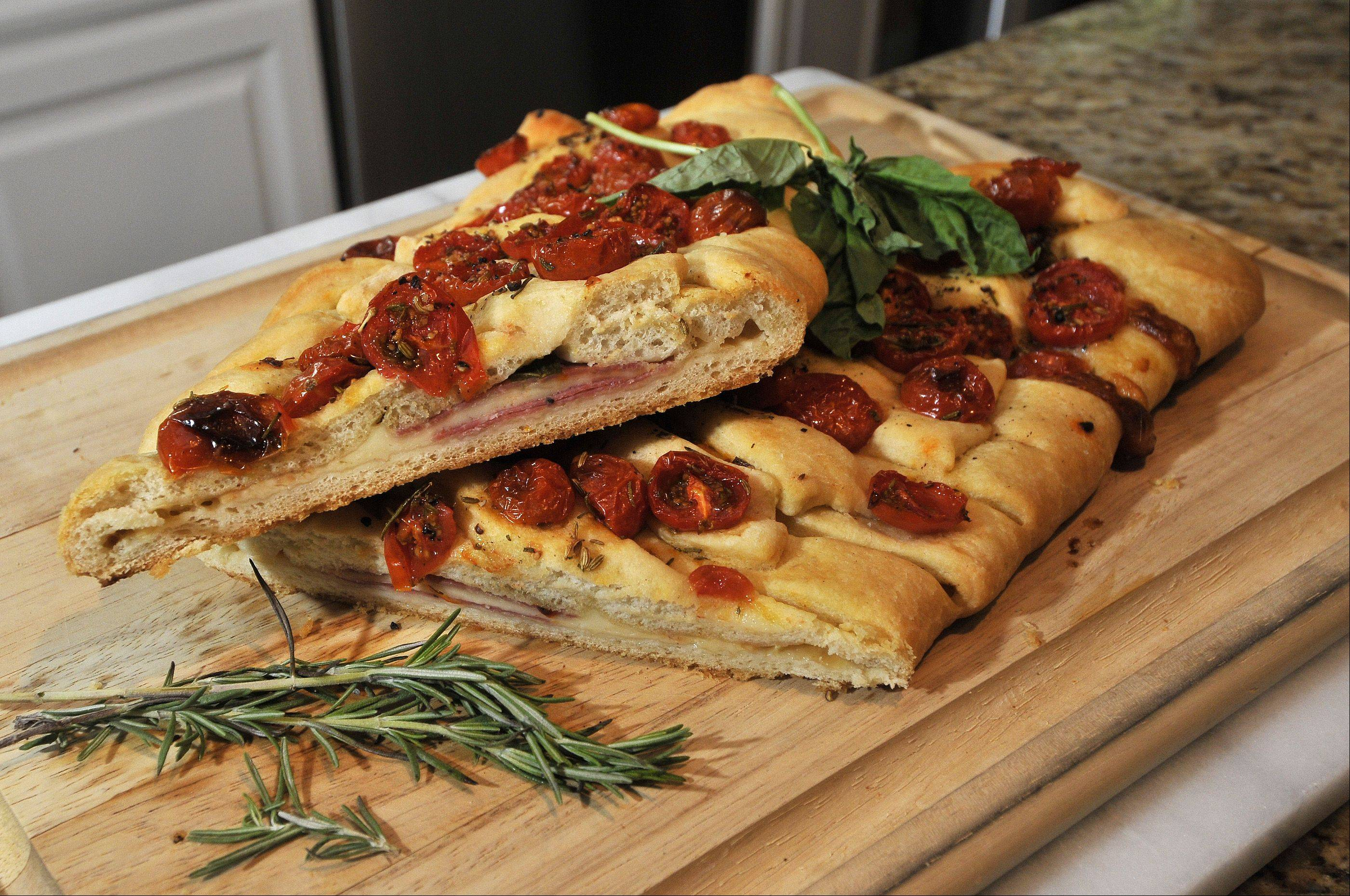 Brian Emmett displays his Italian Stromboli pastry in his Itasca kitchen.