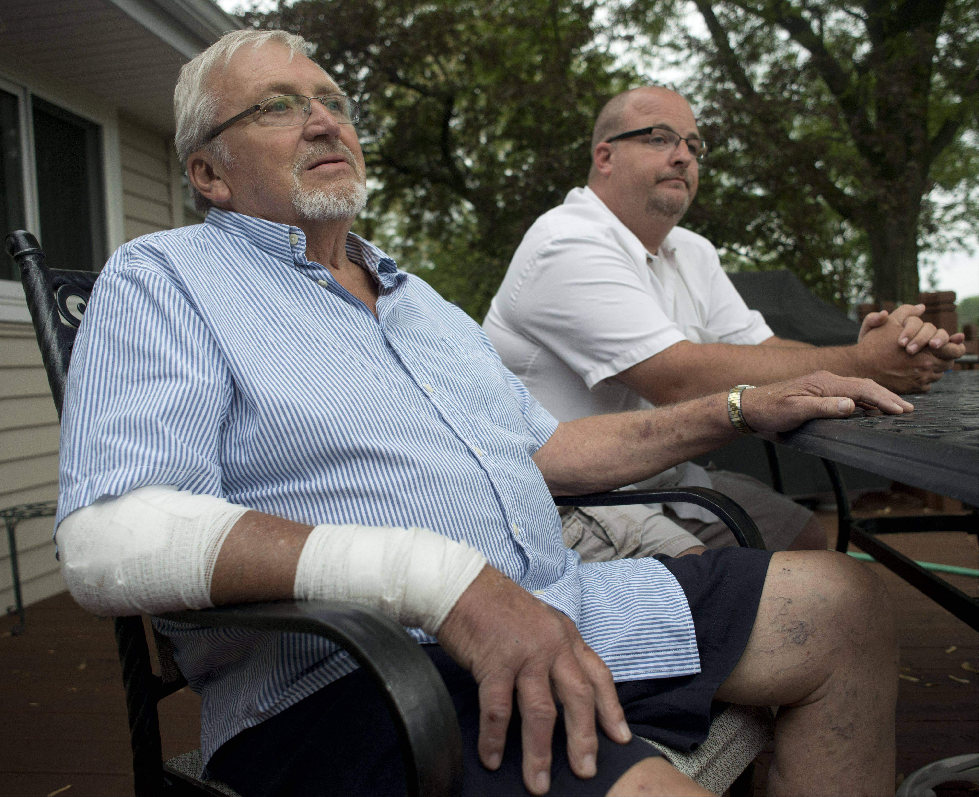 Oklahoma City tornado survivor Frank Kozak, left, talks about the experience while his son Steve sits at his side back at home in Schaumburg Tuesday. Frank's wife Char also survived the tornado and is recovering.