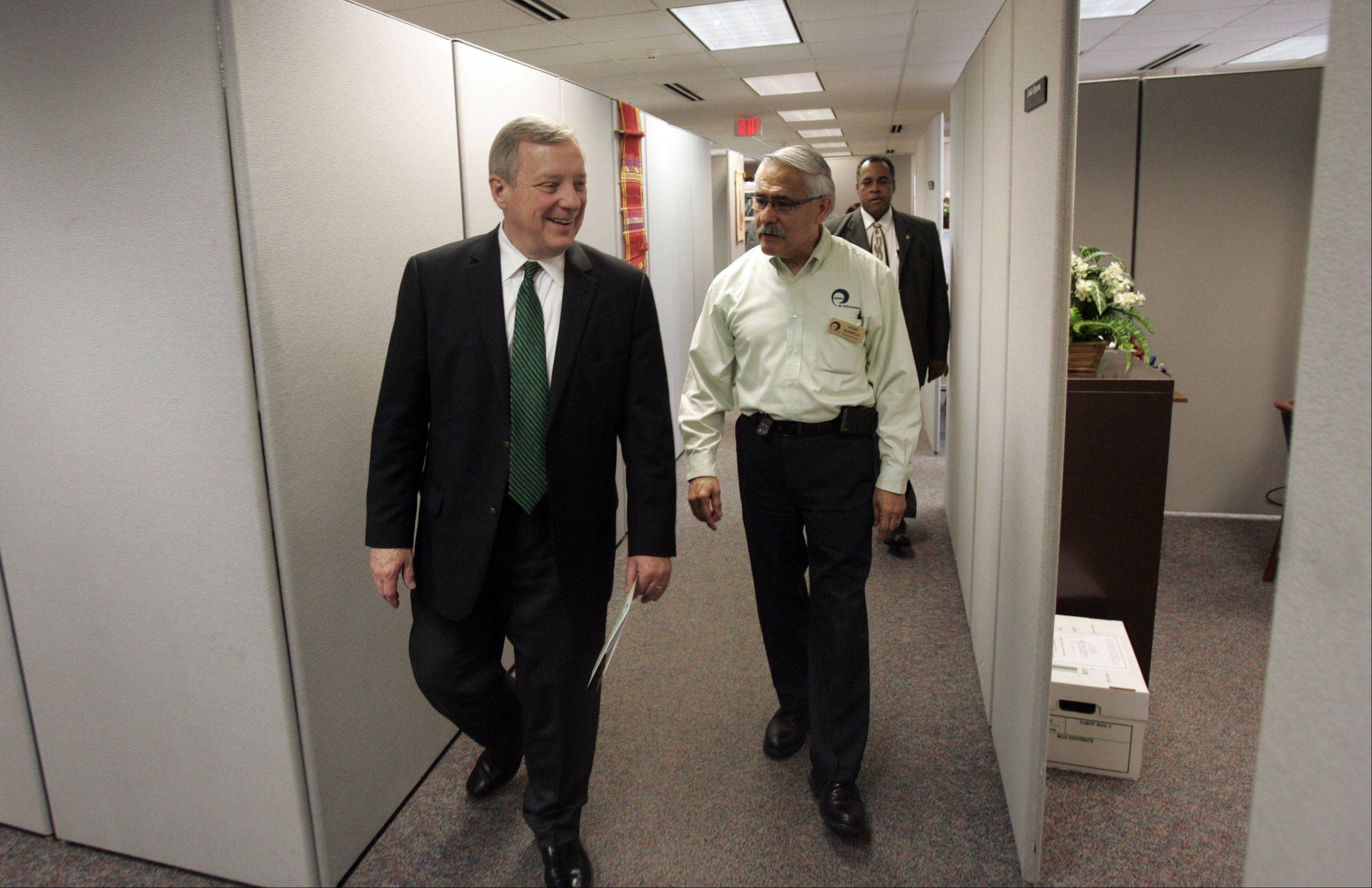 Jaime Garcia, executive director of Centro de Informacion, leads Sen. Dick Durbin on a tour prior to Durbin talking about comprehensive immigration reform to community leaders Tuesday in Elgin.