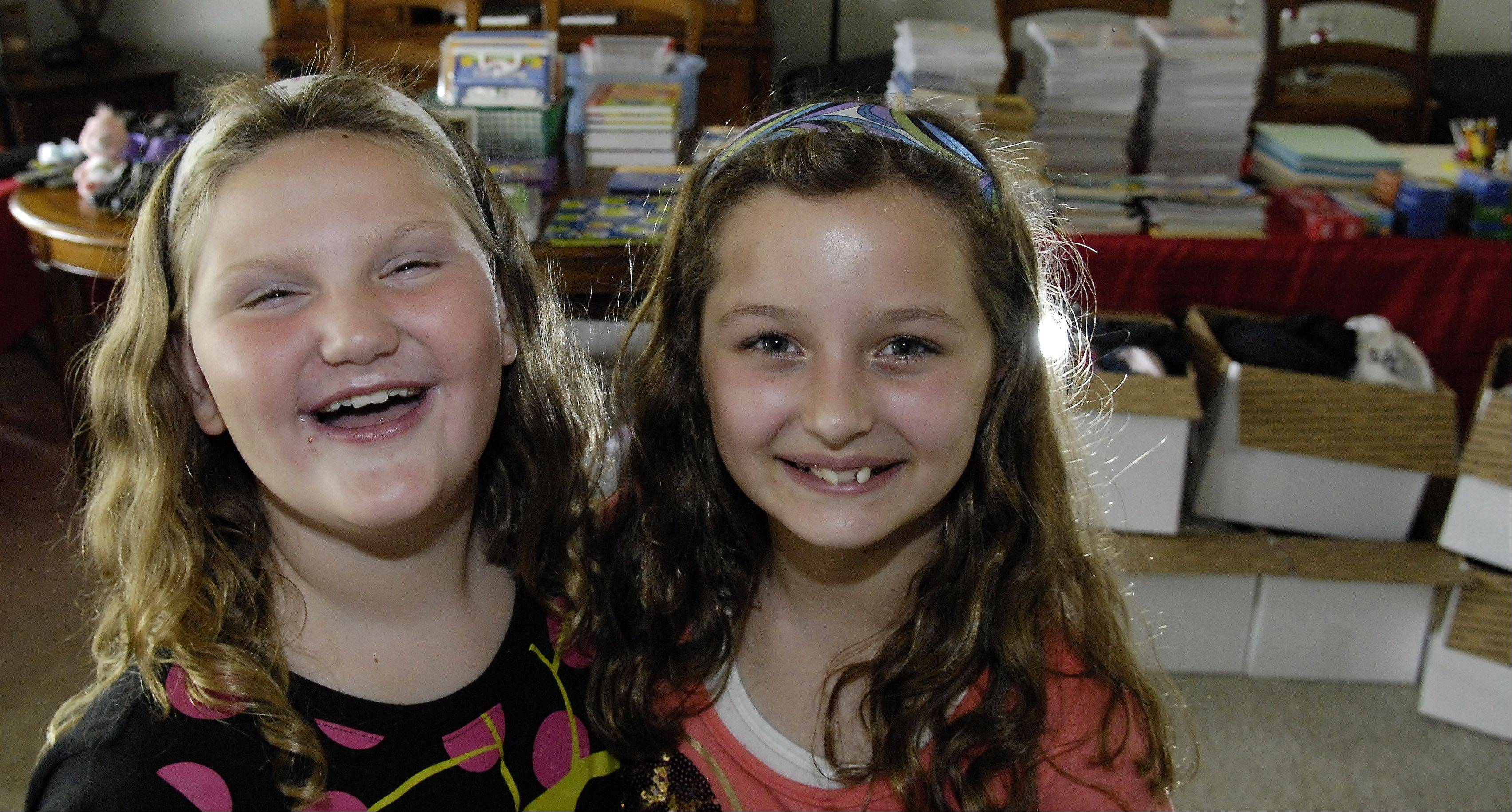 Friends and Blackberry Creek Elementary School students Payton Micka, 8, left, and Kailey Davison, 10, both of Elburn, collected school supplies, clothes and other items to send to tornado victims in Oklahoma.