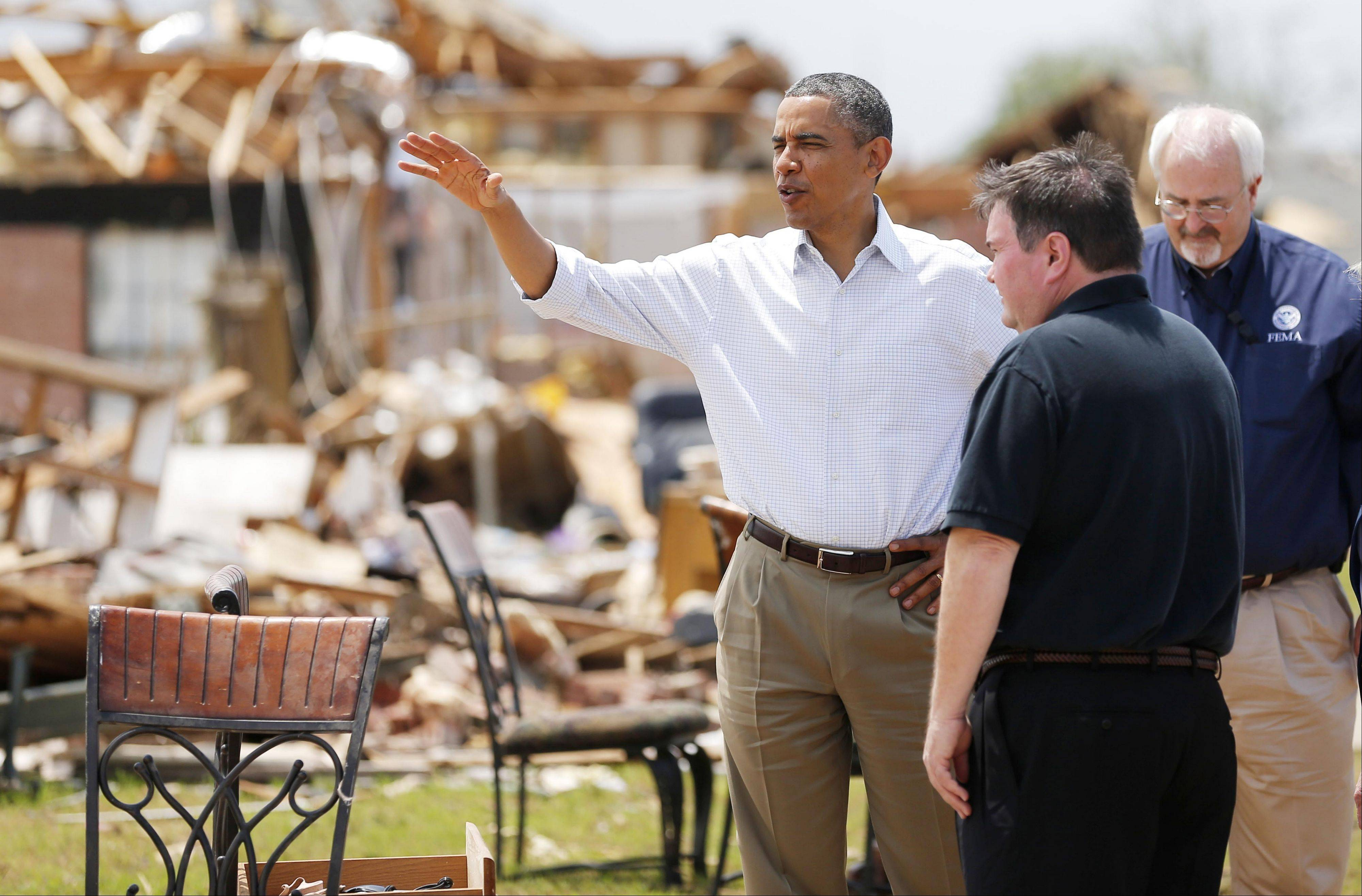 Associated Press President Barack Obama tours the Plaza Towers addition in Moore, Okla., beside Moore Mayor Glenn Lewis. In his 20 years as mayor of the Oklahoma City suburb, Lewis has already rebuilt his town twice, grappling with the aftermath of tornadoes so enormous the probability they strike is barely 2 percent. Yet Moore has been slammed by EF5 tornadoes, the largest on the rating scale, twice.
