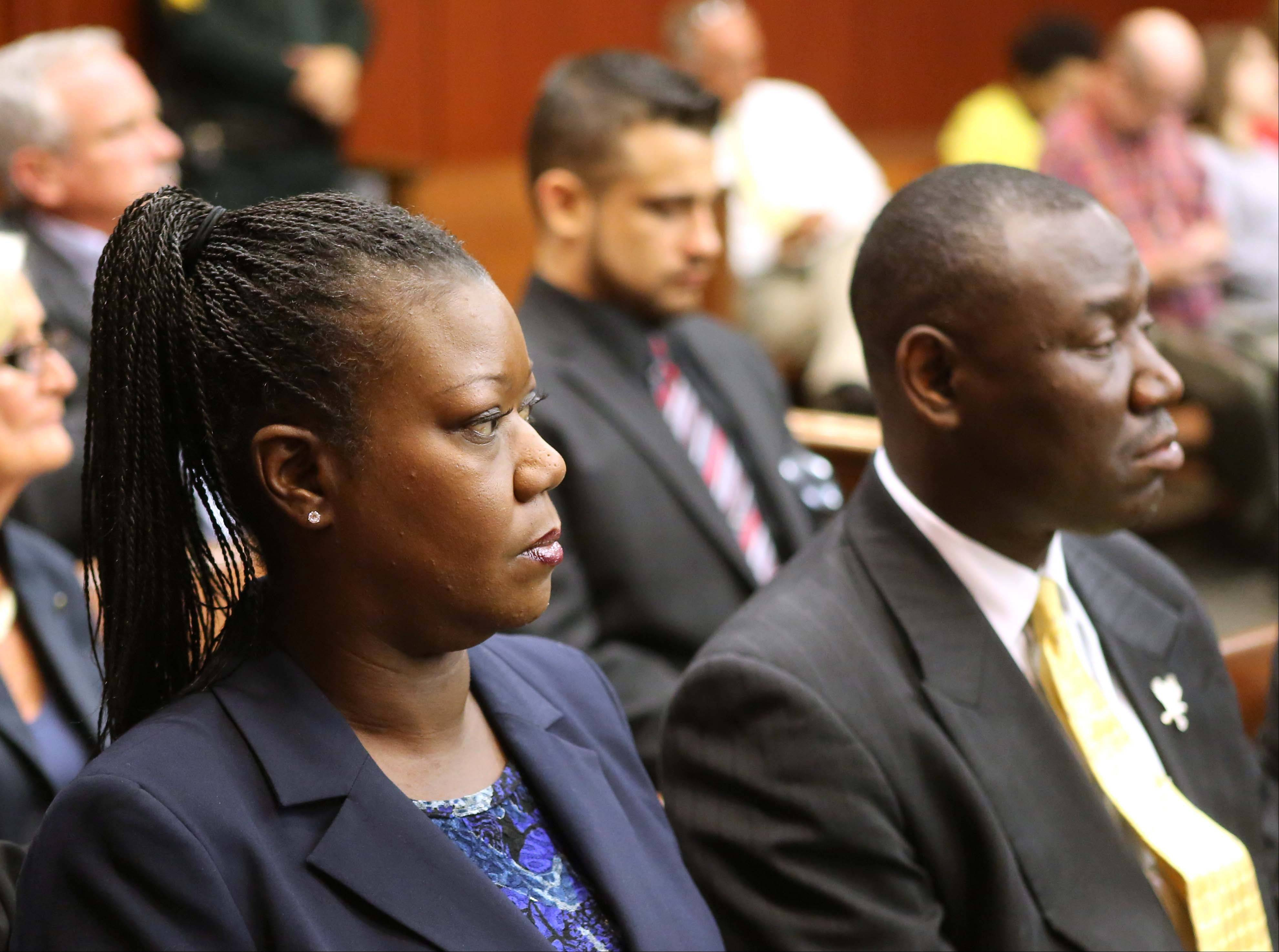 Sybrina Fulton, the mother shooting victim Trayvon Martin, sits with her attorney Benjamin Crump, during a pretrial hearing for George Zimmerman, the accused shooter of Trayvon Martin, Tuesday, May 28, 2013 in Sanford, Fla. Zimmerman has been charged with second-degree murder for the 2012 shooting death of Trayvon Martin. He was not in court for the hearing.