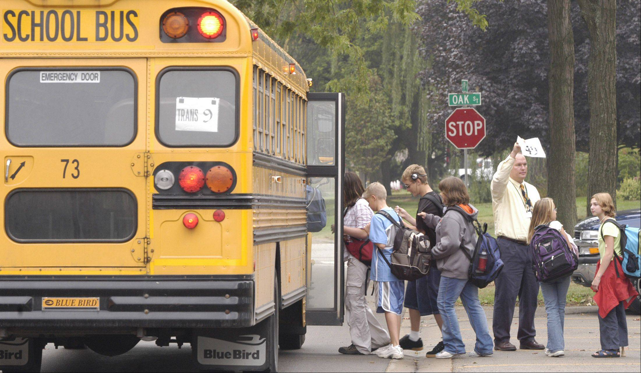 Suburban schools wouldn�t see cuts in state funding for buses under a budget plan being pushed in the state Capitol.