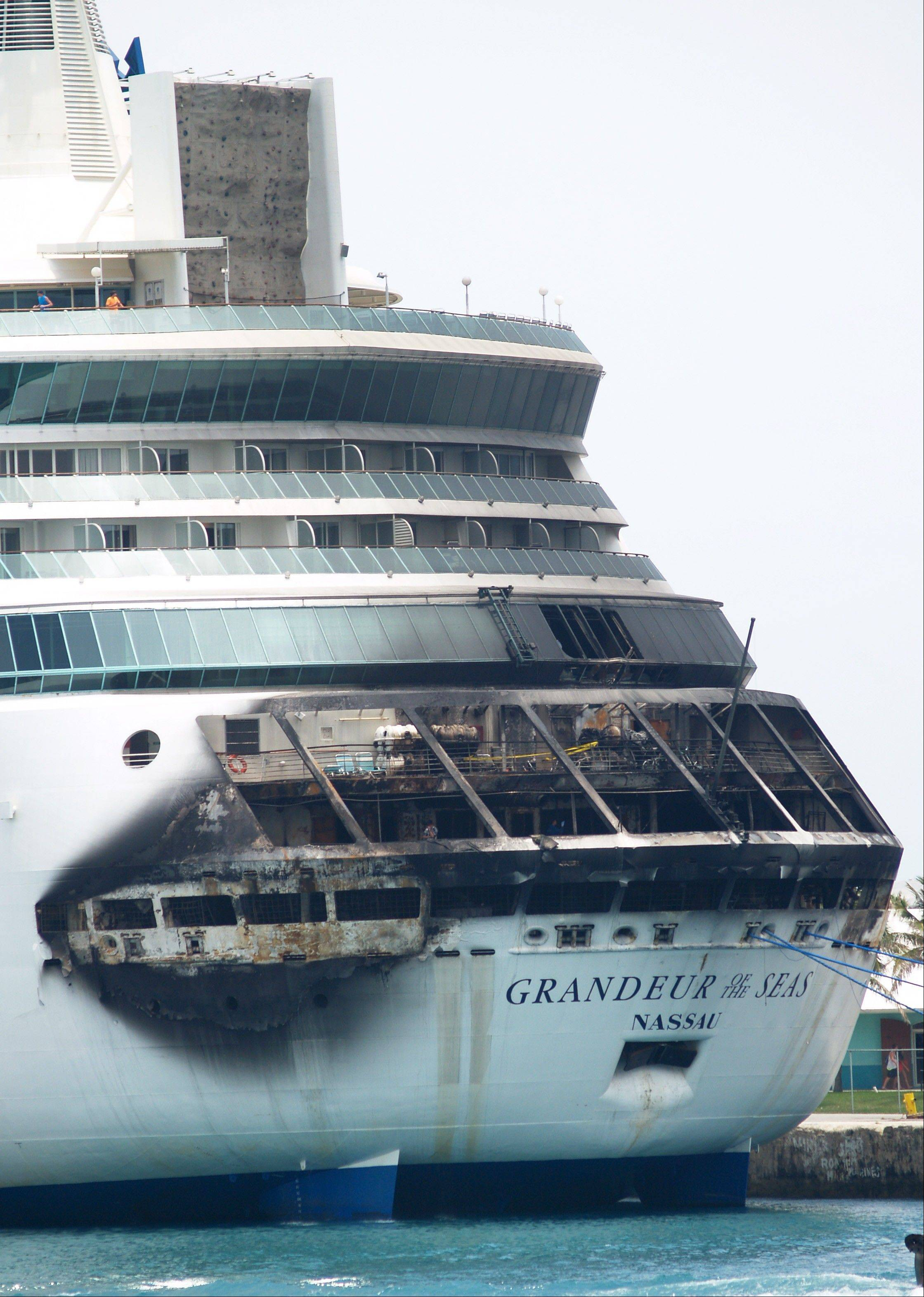 The fire-damaged exterior of Royal Caribbean�s Grandeur of the Seas cruise ship is seen while docked in Freeport, Grand Bahama island, Monday. Royal Caribbean said the fire occurred early Monday while on route from Baltimore to the Bahamas on the mooring area of deck 3 and was quickly extinguished. All 2,224 guests and 796 crew were safe and accounted for.
