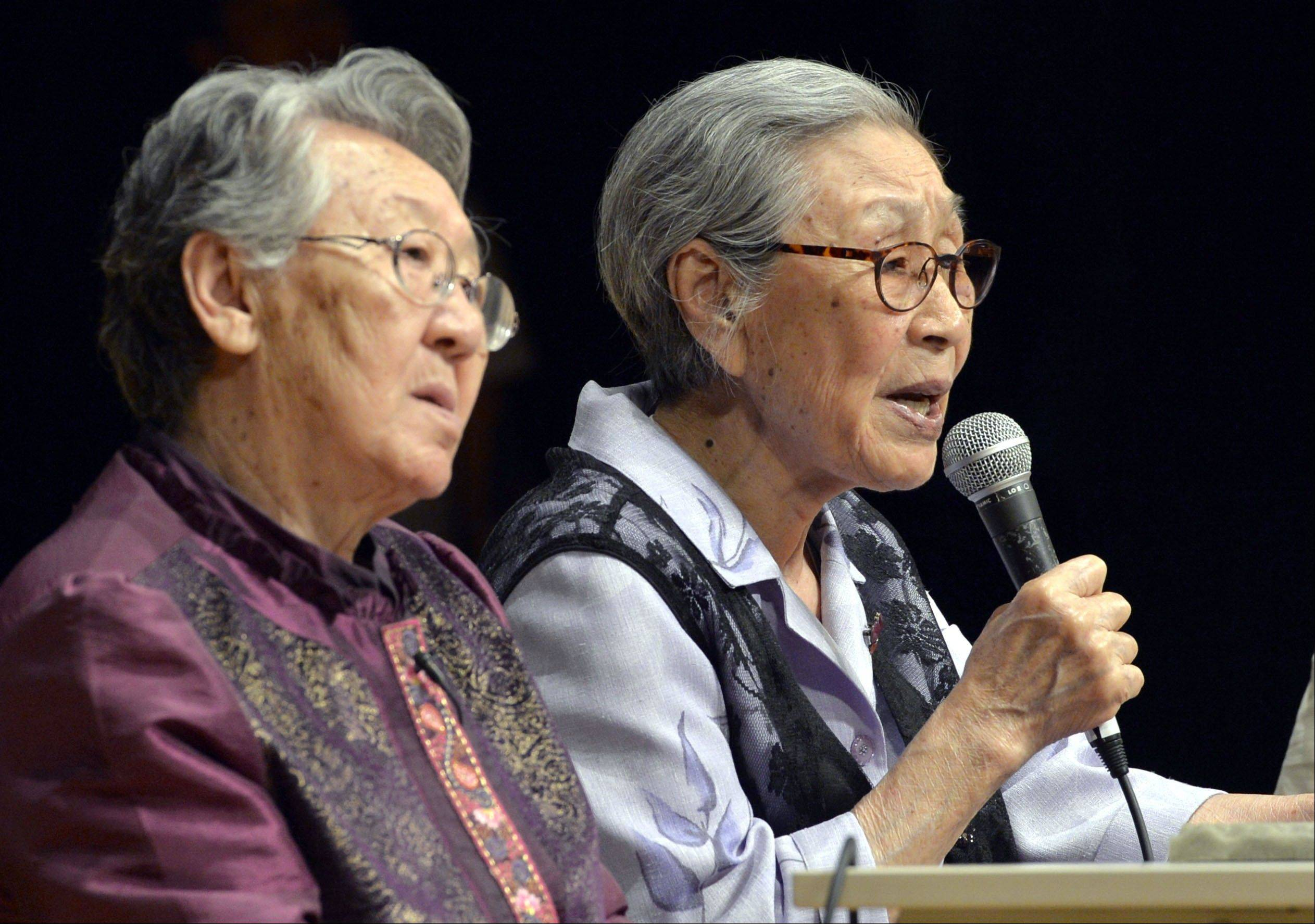 South Korean former sex slaves Kim Bok-dong, right, and Kil Won-ok, left, attend a meeting in Osaka, western Japan. More than 70 years ago, at age 14, Kim Bok-dong was ordered to work by Korea�s Japanese occupiers. She was told she was going to a military uniform factory, but ended up at a Japanese-military-run brothel in southern China.