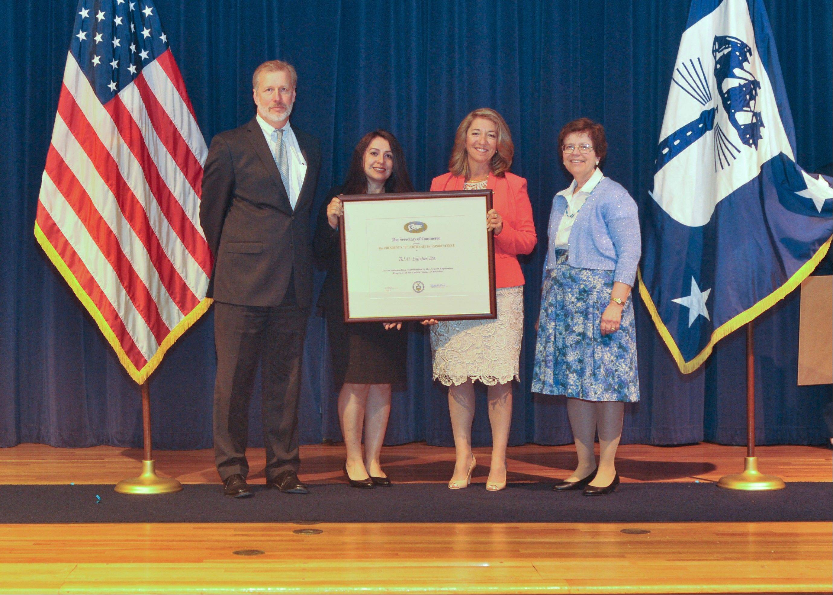 U.S. Acting Deputy Under Secretary for International Trade Kenneth E. Hyatt, from left, Matilda Vazquez, RIM Logistics export compliance manager; Sheila Serafin, RIM Logistics vice president of global accounts; and U.S. Acting Secretary of Commerce Rebecca Blank.
