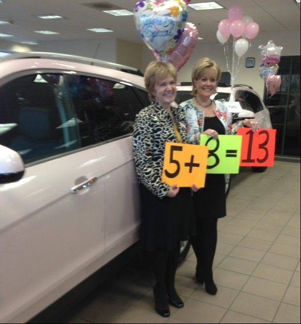 Patty Bojan, left, and Deborah Bailye earned five and eight pink Cadillacs, respectively, as Mary Kay cosmetic saleswomen.