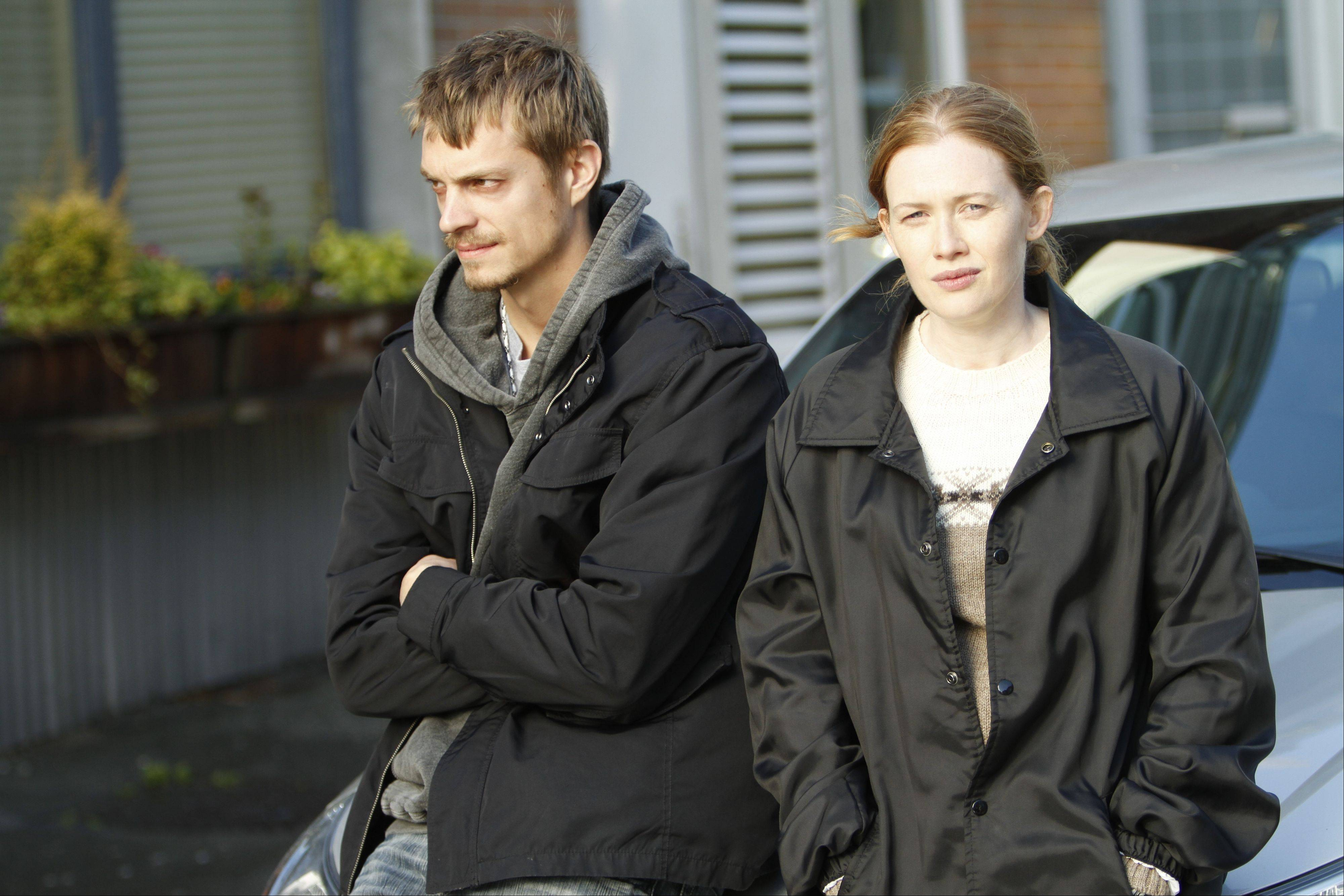 "Detective Stephen Holder (Joel Kinnaman) consults with his former partner Sarah Linden (Mireille Enos) in AMC's ""The Killing,"" returning for a third season on June 2."