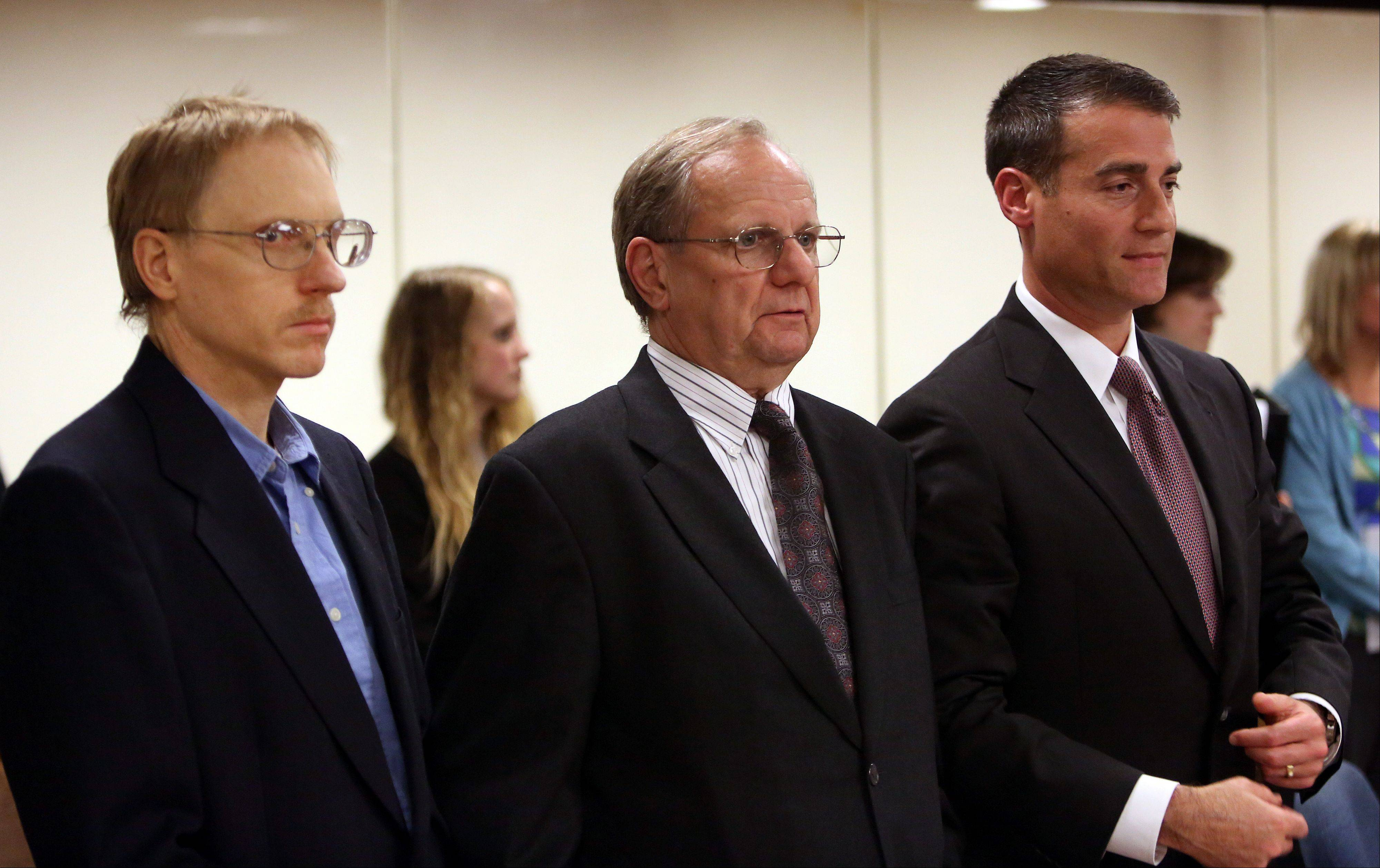 Ronald Stolberg, left, stands with his attorneys William Hedrick, middle, and Kevin Rosner during court Tuesday. Stolberg was convicted of involuntary manslaughter in the 2011 death of his wife, Rachel Stolberg, in the courtroom of Judge Mark Levitt in Lake County on Tuesday, May 28, 2013, in Waukegan.