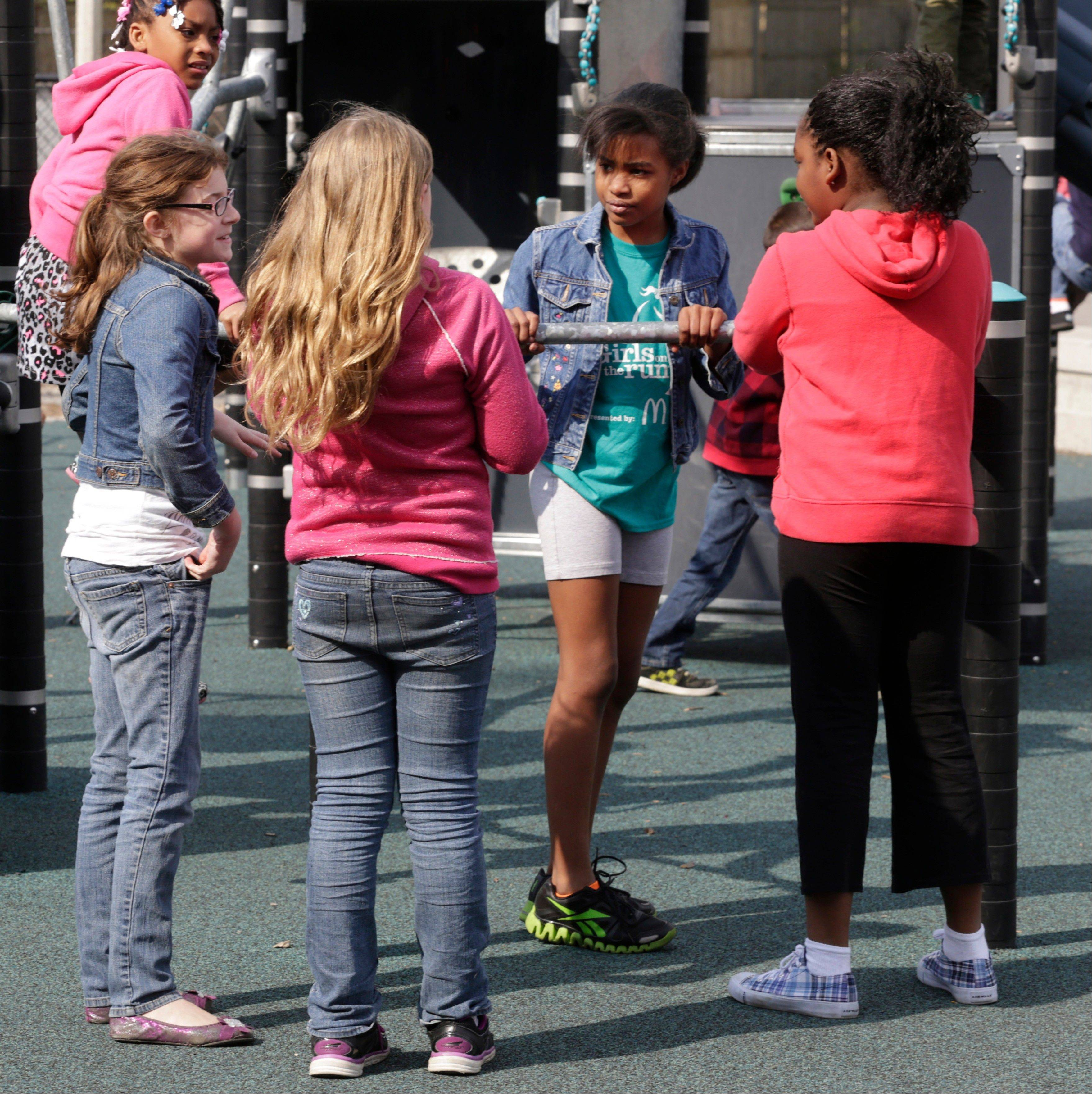 "Ryan, a ""gender variant"" fourth grader, talks with friends during recess at her suburban Chicago school in early May."