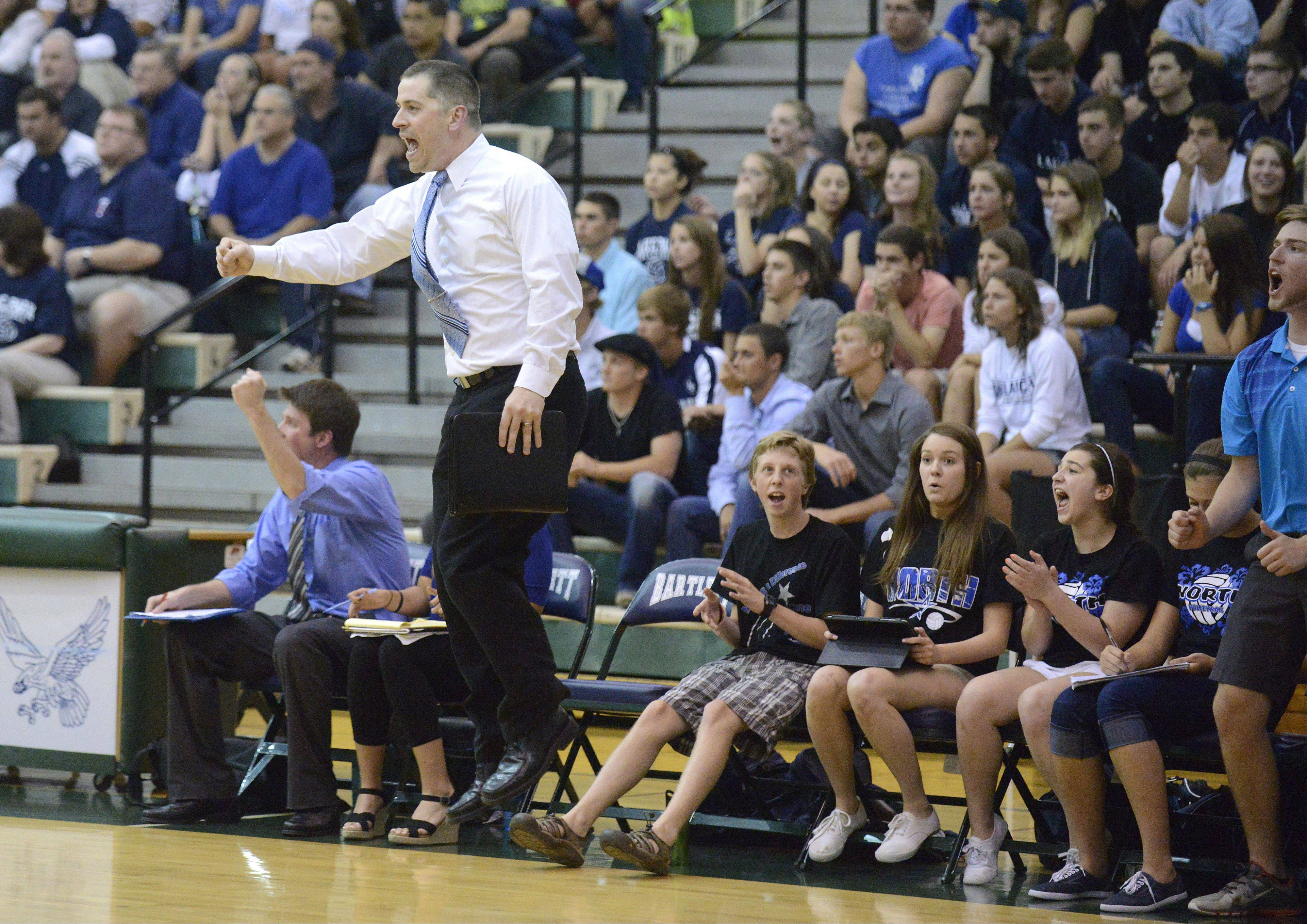 St. Charles North coach Todd Weimer celebrates getting a point closer to the North Stars winning the second game in Tuesday's sectional against Lake Park at Bartlett.