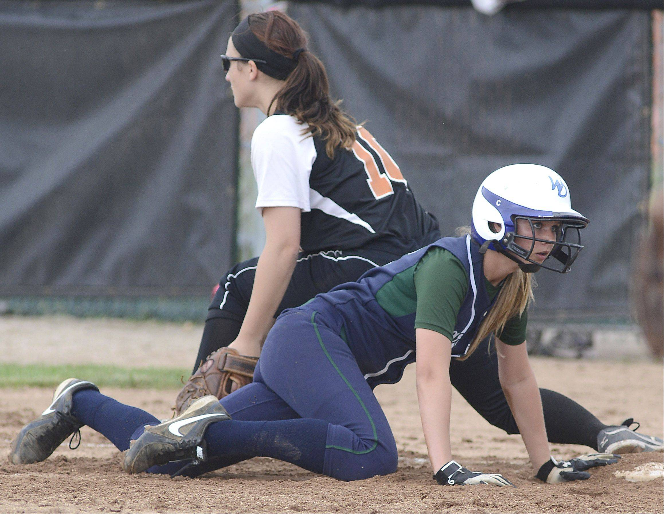 Bartlett's St. Charles East's Kate Peterburs tags out Bartlett's Kathryn Fornoff in the third inning of the Class 4A sectional on Tuesday.