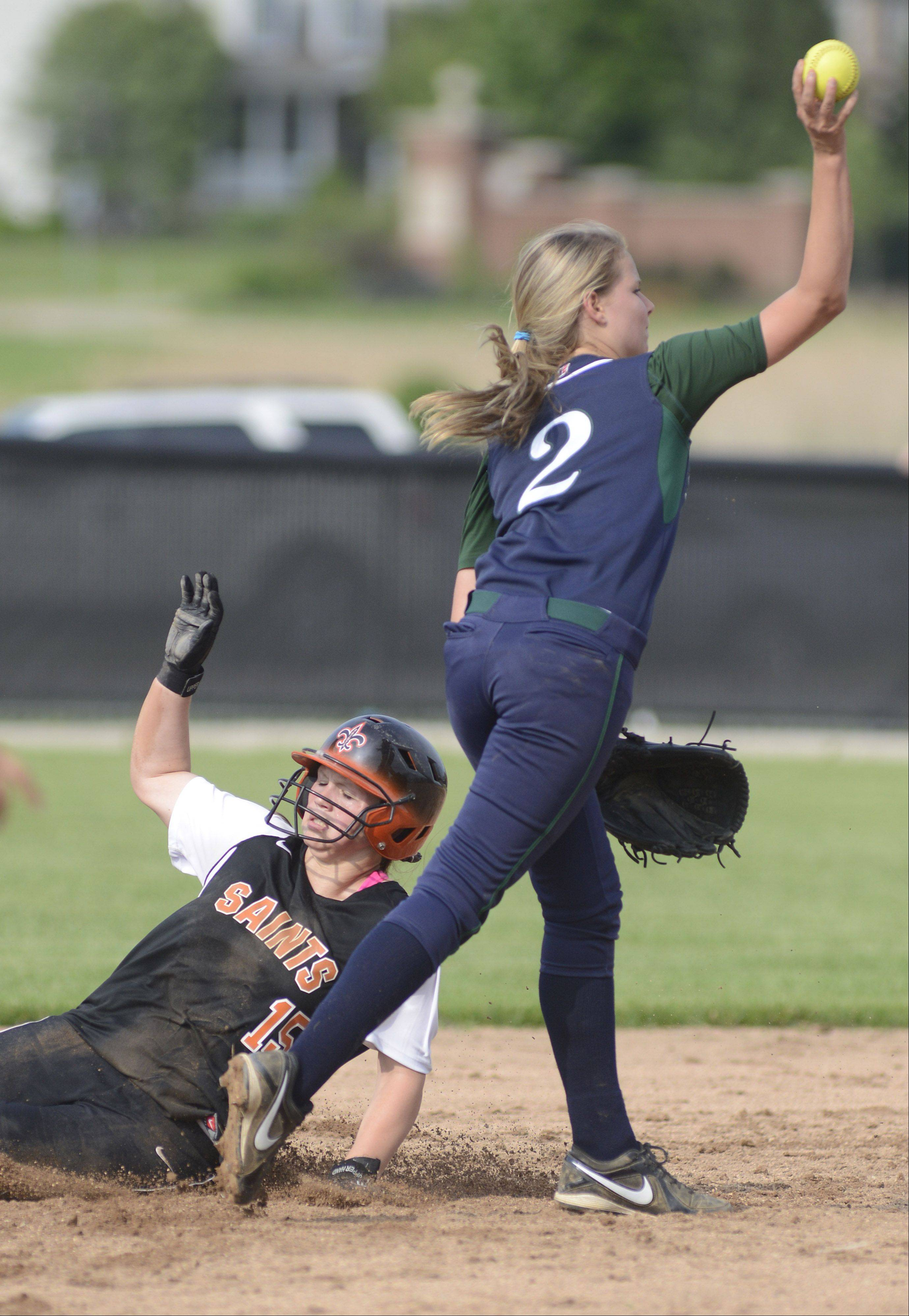 St. Charles East's Alex Latoria is tagged out at second base by Bartlett's Kathryn Fornoff in the third inning of the Class 4A sectional on Tuesday.