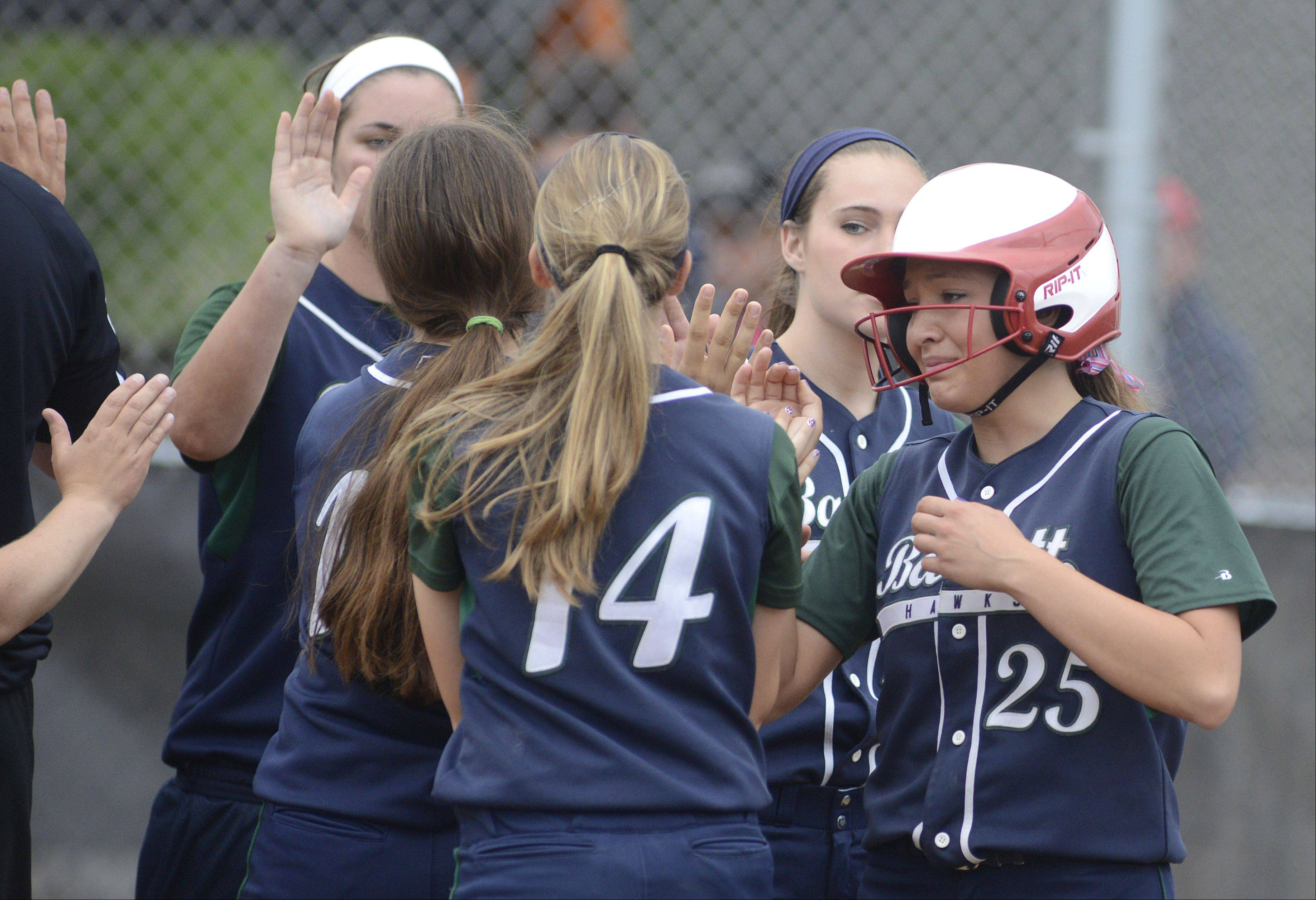 Bartlett senior Cara Carrion fights back tears after losing to St. Charles East in the Class 4A sectional on Tuesday.
