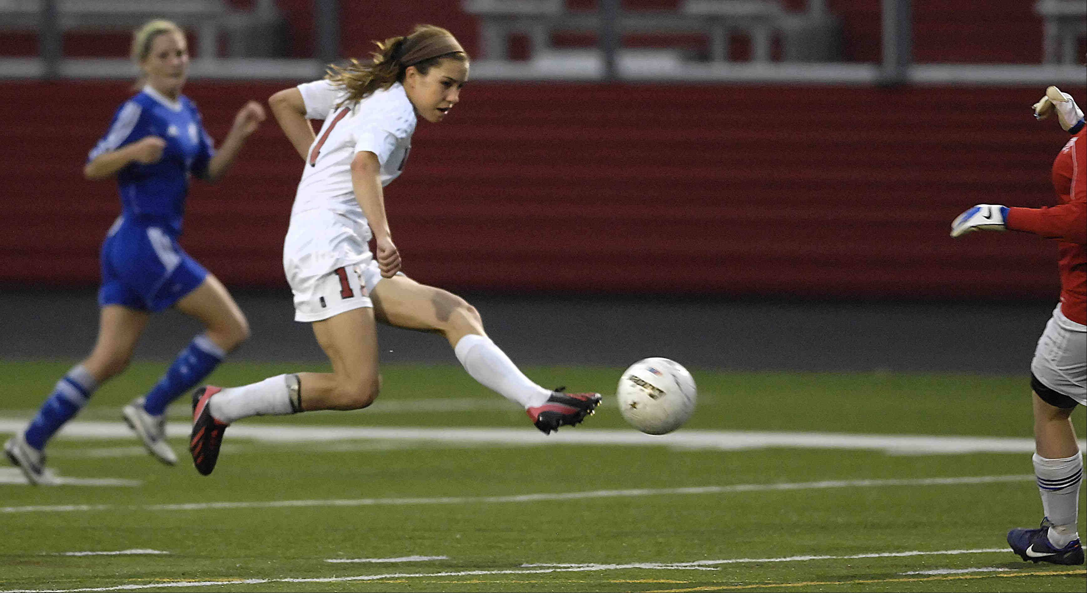 Barrington's Jenna Szczesny kicks a first-half goal against St. Charles North Tuesday in the supersectional game in Barrington, before it was delayed by lightning.