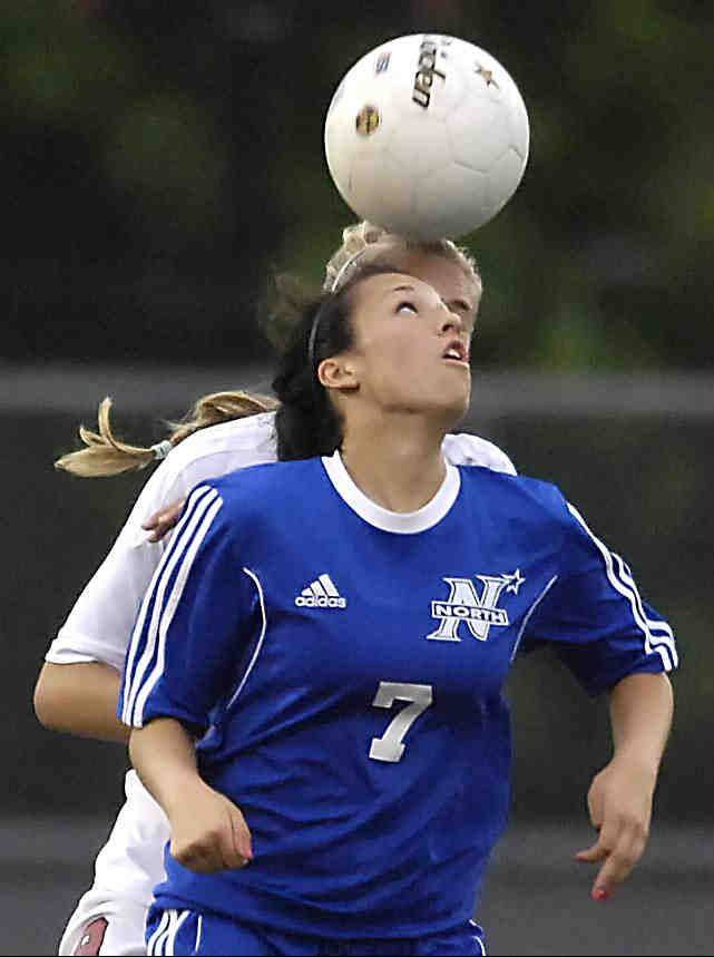 St. Charles North's Ashlyn Walter and Barrington's Emily Morin eye a header Tuesday in the supersectional in Barrington before it was delayed by lightning.