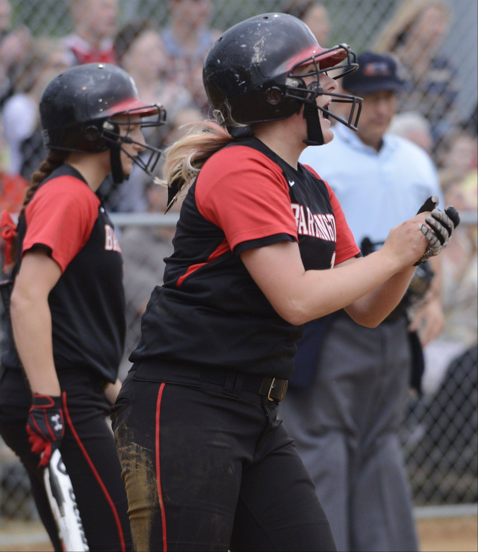 Barrington's Morgan Olszewski celebrates as she scores a run against Fremd during the Rolling Meadows sectional semifinal Tuesday.