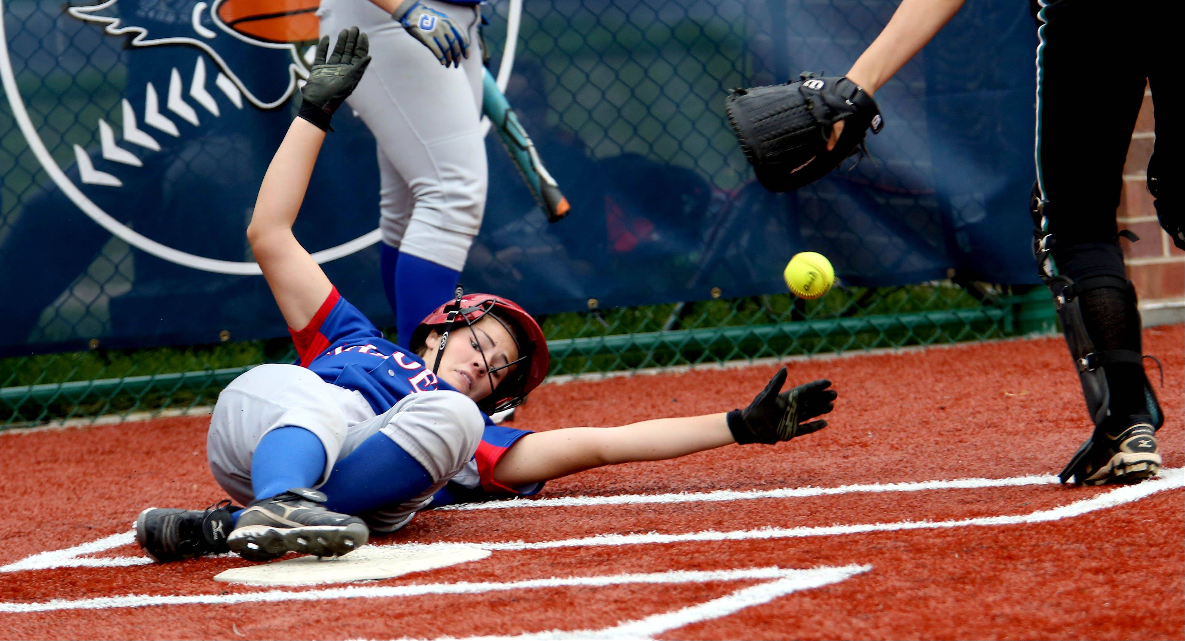 Jane Trzaska of Glenbard South slides into home plate ahead of the ball in the first inning during action against Evergreen Park in Class 3A sectional semifinal softball on Tuesday in La Grange.
