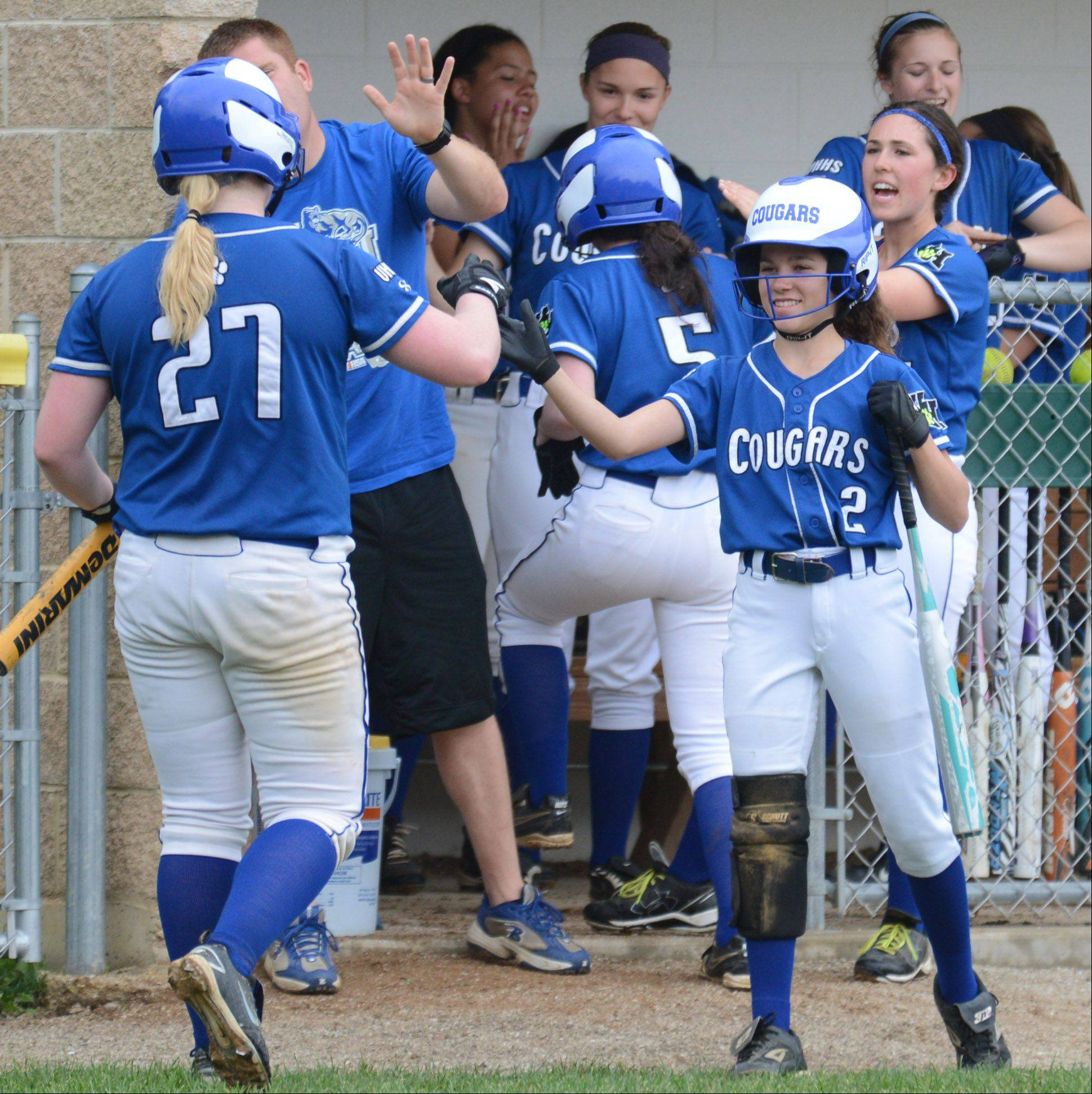 Vernon Hills' Izzy Cirone (2) high-fives Jen Claussen after scoring against Northside Prep during Tuesday's Class 3A sectional semifinal game in Grayslake.