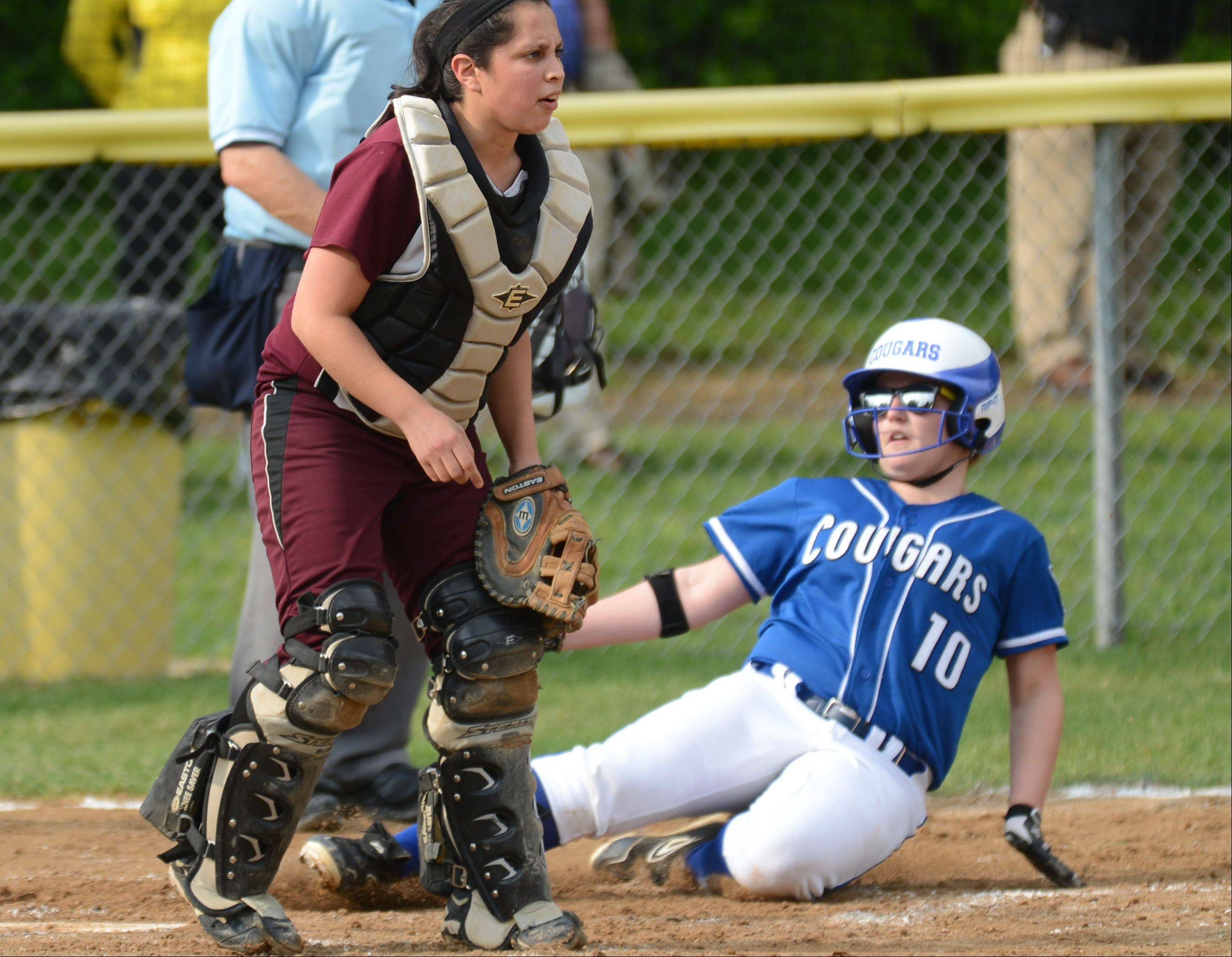 Northside Prep catcher Angela Villagomez waits for the throw as Vernon Hills' Sami Saliba scores during Tuesday's Class 3A sectional semifinal game in Grayslake.