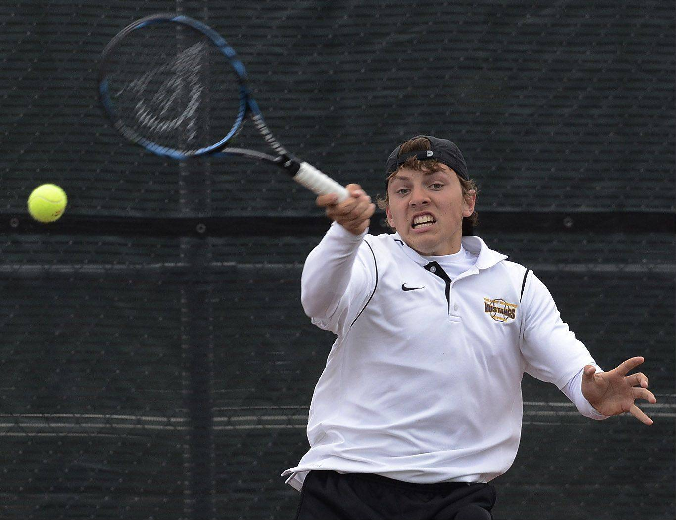Rolling Meadows' Mack Galvin plays during Thursday's state tennis tournament.