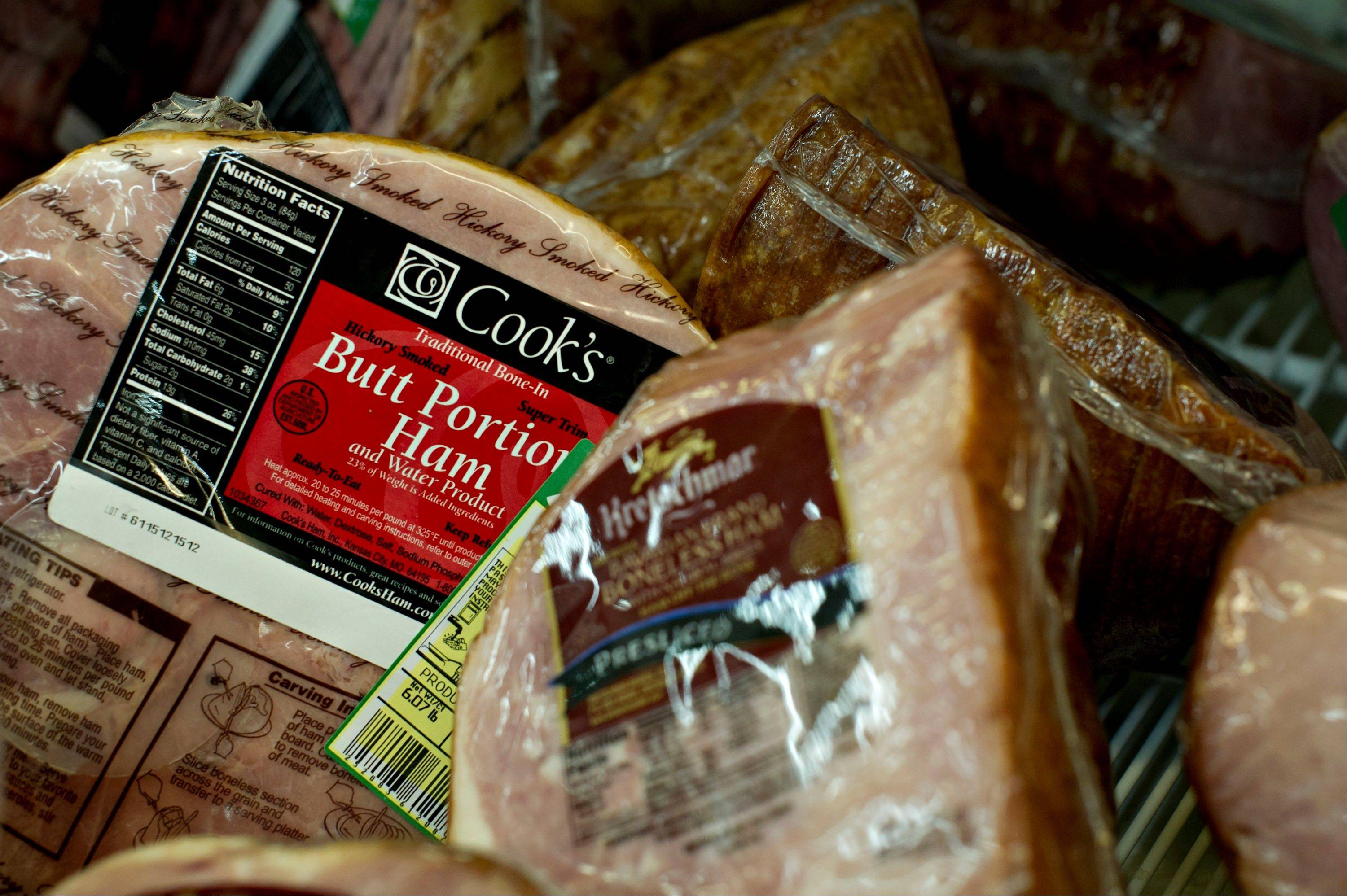 Smithfield Foods Inc. Cook�s brand ham sits on display at a supermarket in Princeton, Illinois. Chinese meat processor Shuanghui International Holdings Ltd. has agreed to buy Smithfield Foods for approximately $4.72 billion.