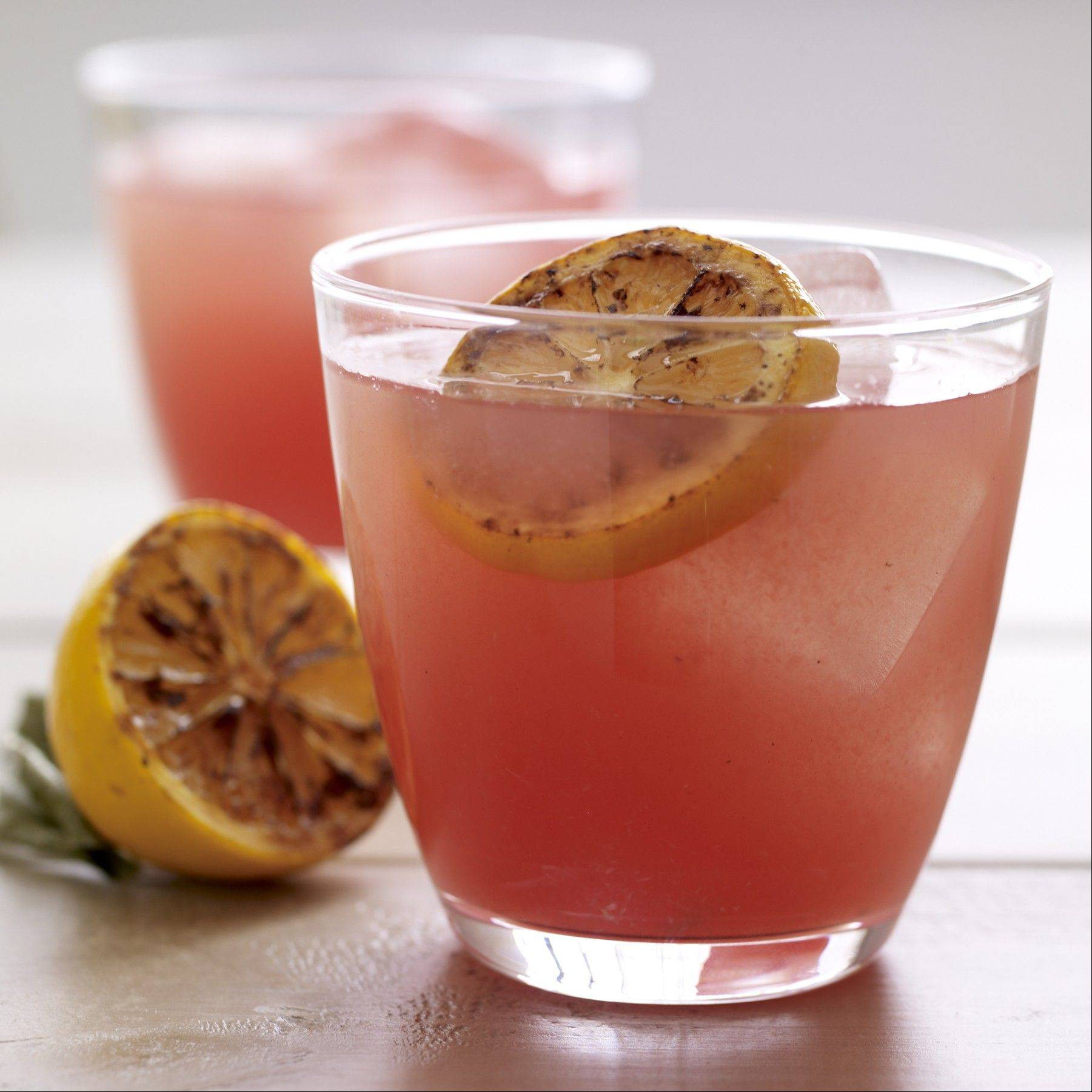 Grilled lemon adds a savory sensation to watermelon lemonade.