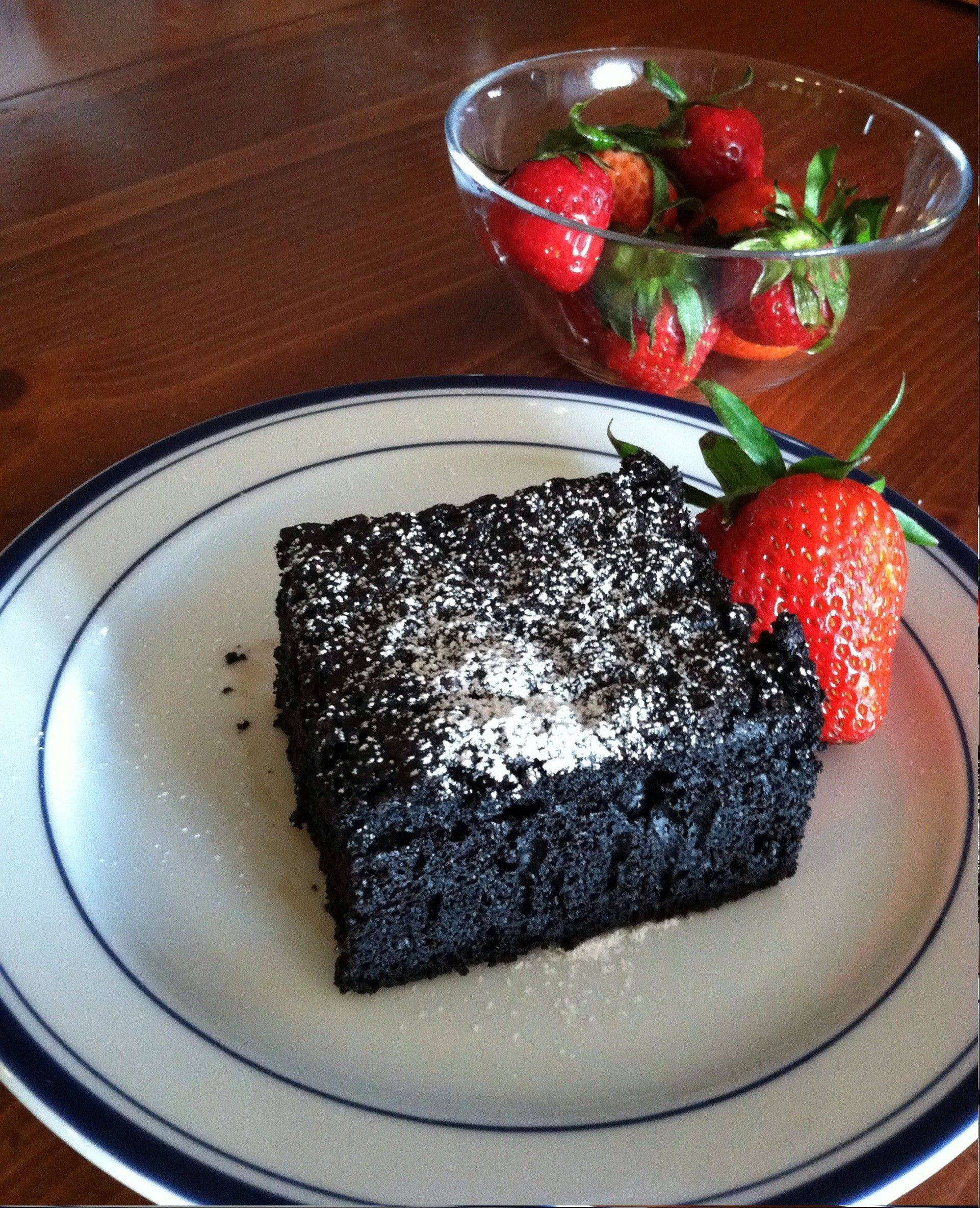 Apple sauce and olive oil keep the fat in check in a rich, dark chocolate cake.