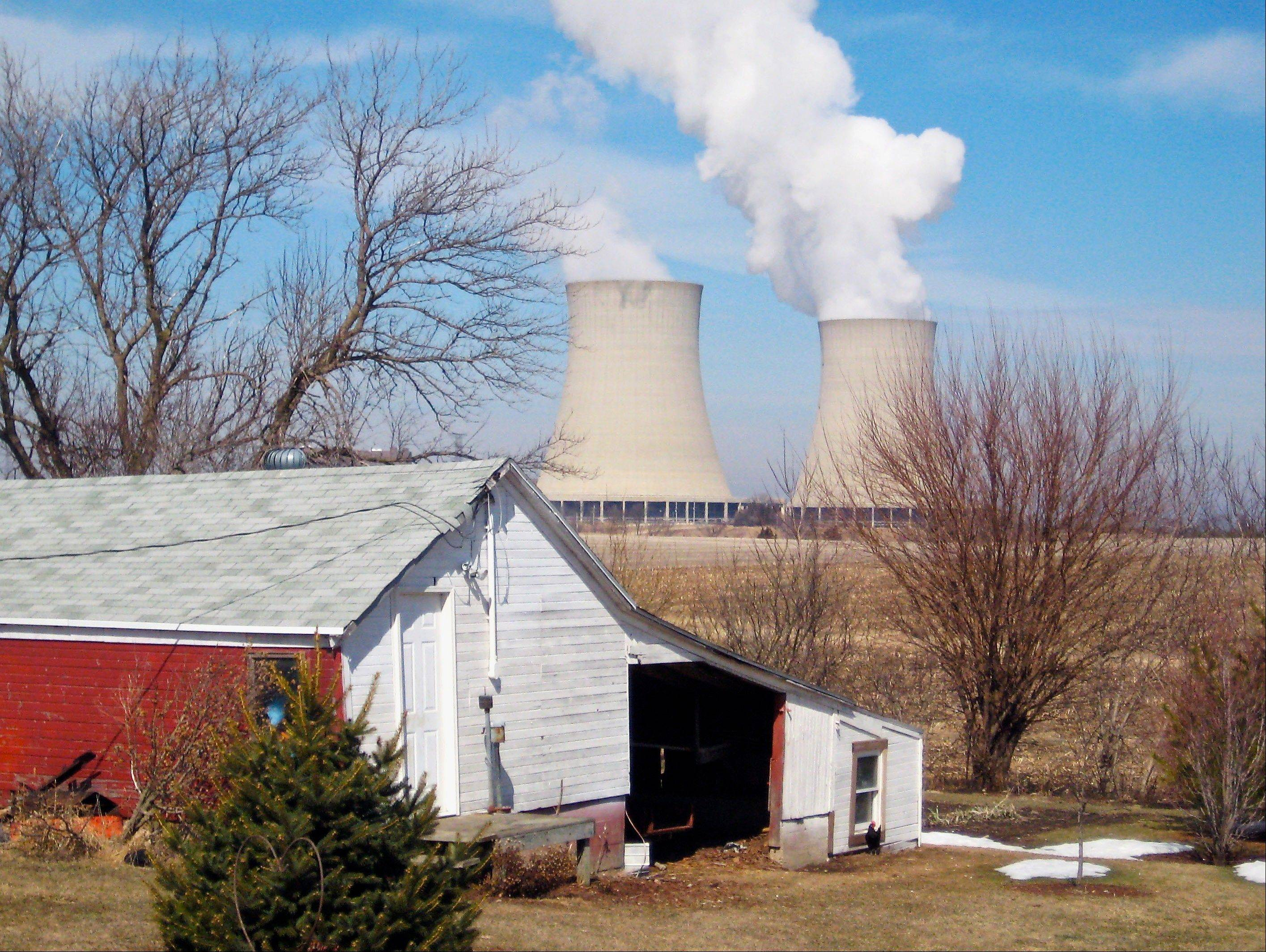 Steam rises from cooling towers at Exelon Generation�s nuclear plant in Byron, Ill.