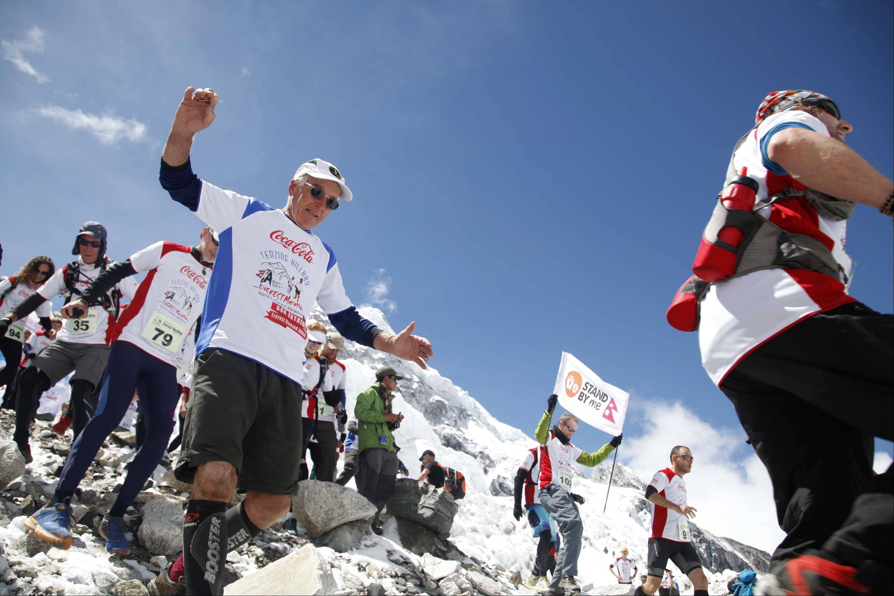Participants of the Tenzing Hillary Everest Marathon begin their race at the Everest base camp in the Khumbu region of the Nepal Himalayas, Wednesday, May 29, 2013. Nepal celebrated the 60th anniversary of the conquest of Mount Everest on Wednesday by honoring climbers who followed in the footsteps of Edmund Hillary and Tenzing Norgay.