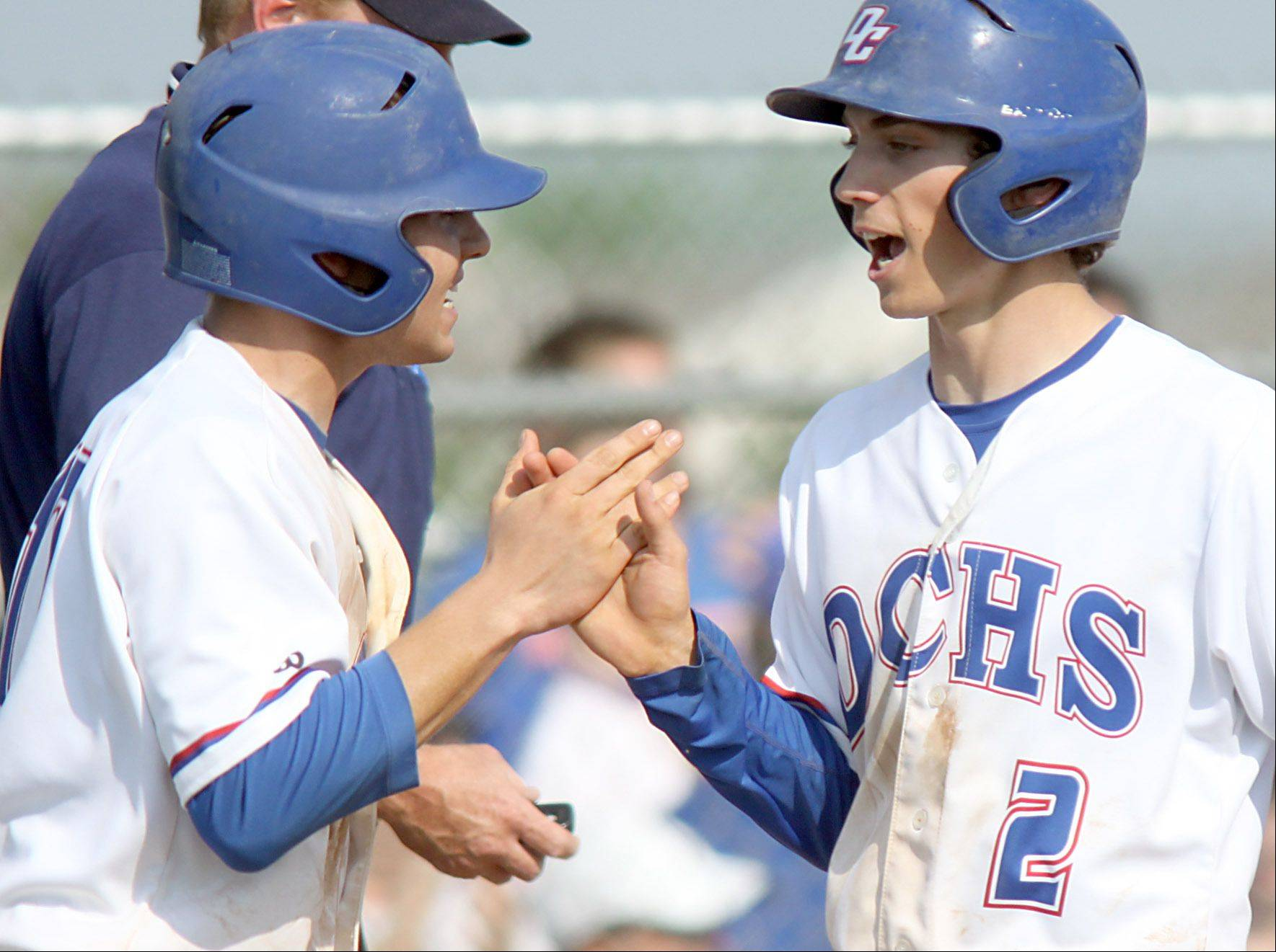 Dundee-Crown�s Zach Girard, left, greets Garrett Ryan at home as Ryan scored during a sectional semifinal game at Huntley against Prairie Ridge on Wednesday night. The Chargers won 15-4.