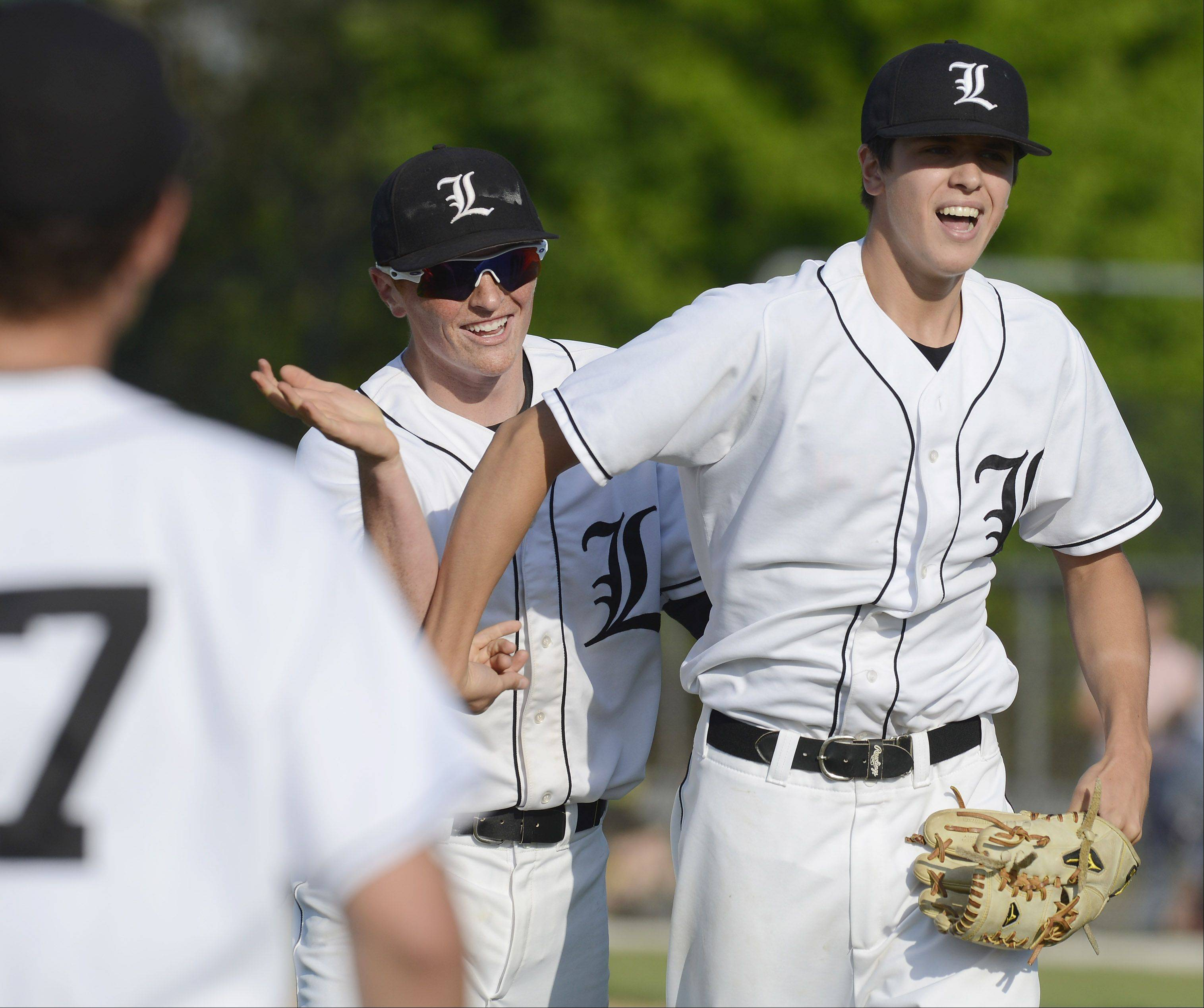 Libertyville pitcher Nate Cote celebrates with his teammates after the Wildcats defeated Fremd 2-1 during the Glenbrook North sectional semifinal Wednesday.