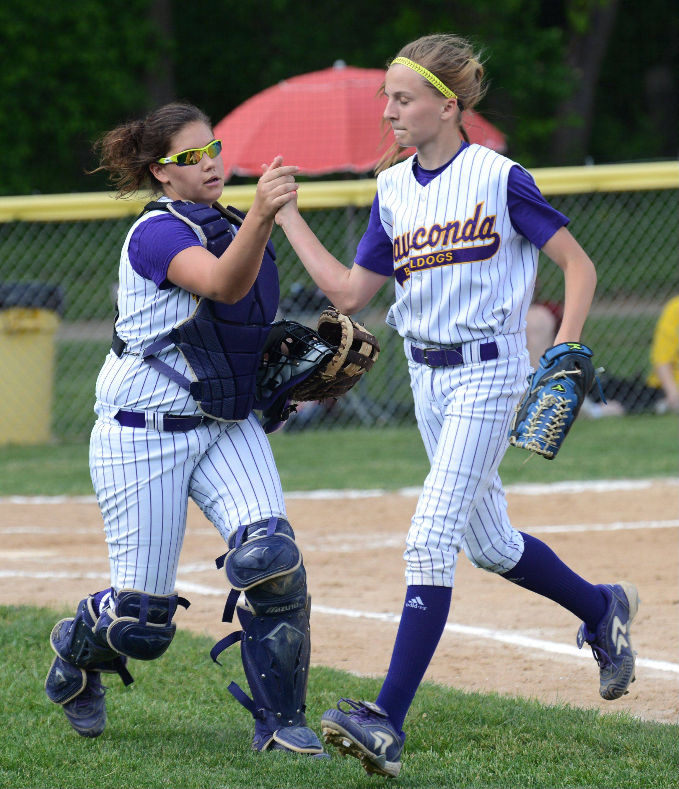 Wauconda catcher Alex Kinnamon, left, gives kudos to pitcher Kayla Wedl after a good inning during Wednesday�s Class 3A sectional semifinal game against Antioch in Grayslake.