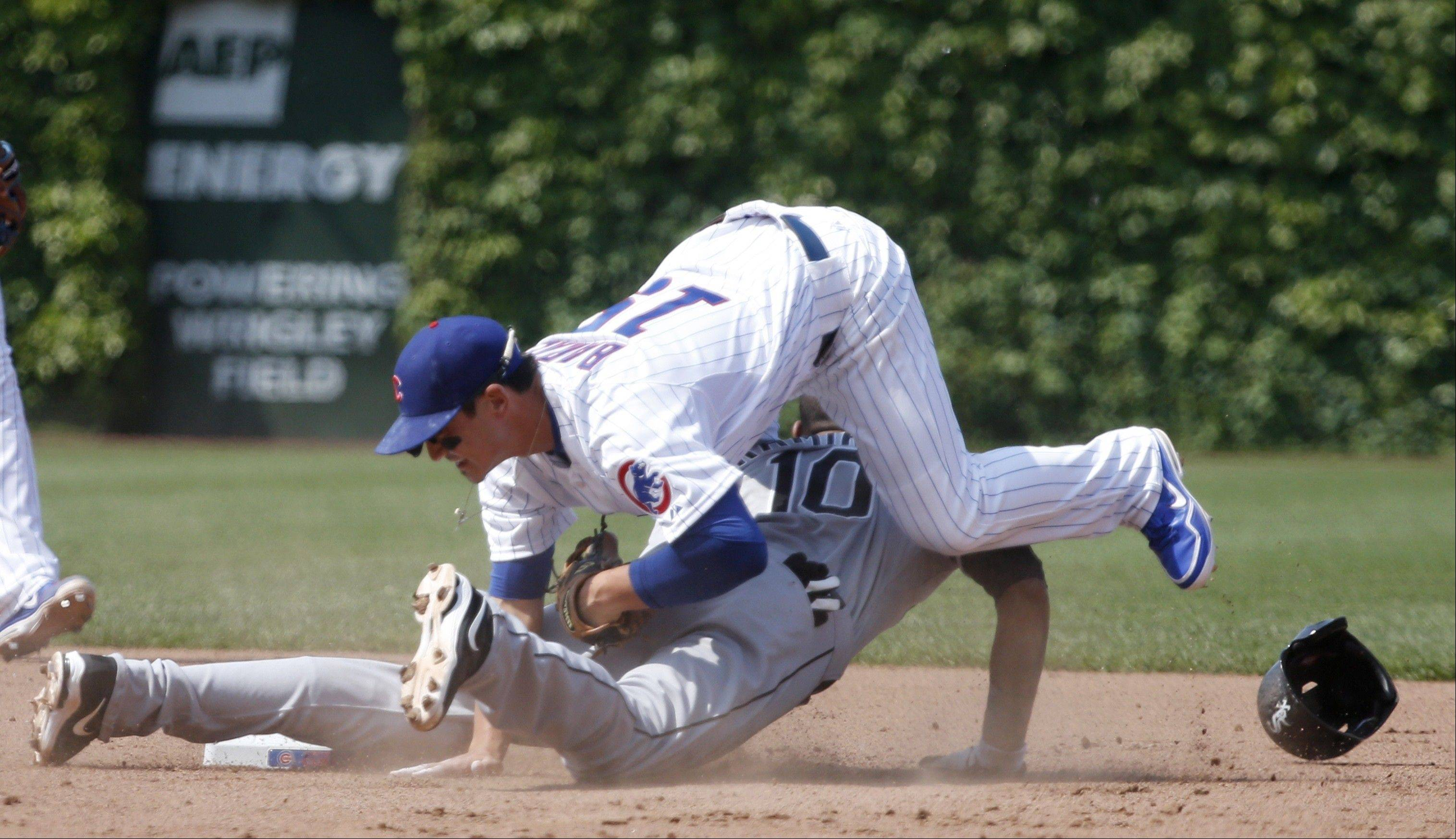 Chicago White Sox's Alexei Ramirez steals second as Chicago Cubs second baseman Darwin Barney (15) is unable to handle a throw from catcher Dioner Navarro during the fifth inning of a interleague baseball game Wednesday, May 29, 2013, in Chicago. (AP Photo/Charles Rex Arbogast)
