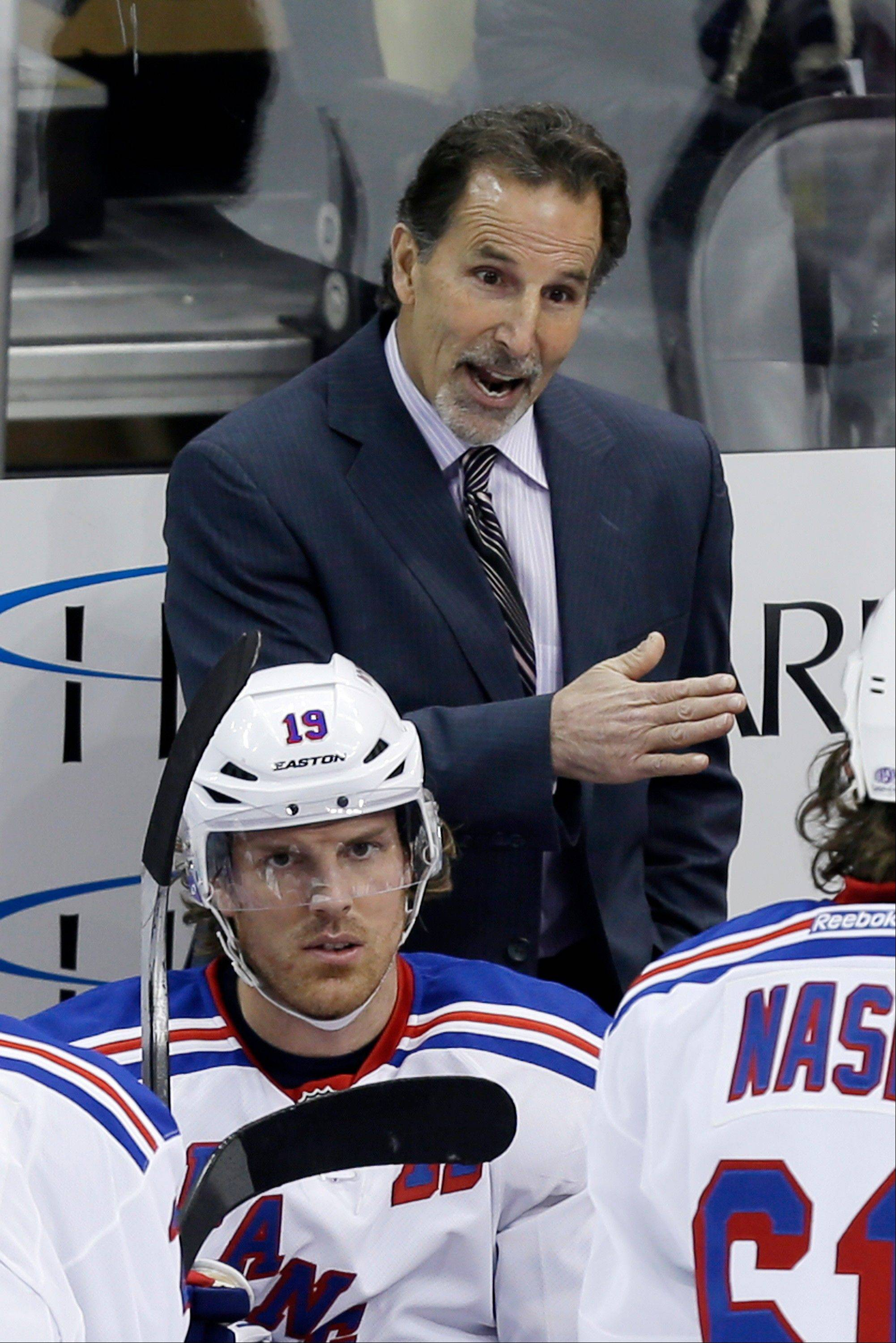 FILE - In this April 5, 2013 file photo, New York Rangers head coach John Tortorella stands behind his bench during an NHL hockey game against the Pittsburgh Penguins in Pittsburgh. The Rangers have fired coach Tortorella, Wednesday, May 29, 2013, four days after New York was eliminated from the Stanley Cup playoffs. (AP Photo/Gene J. Puskar, File)