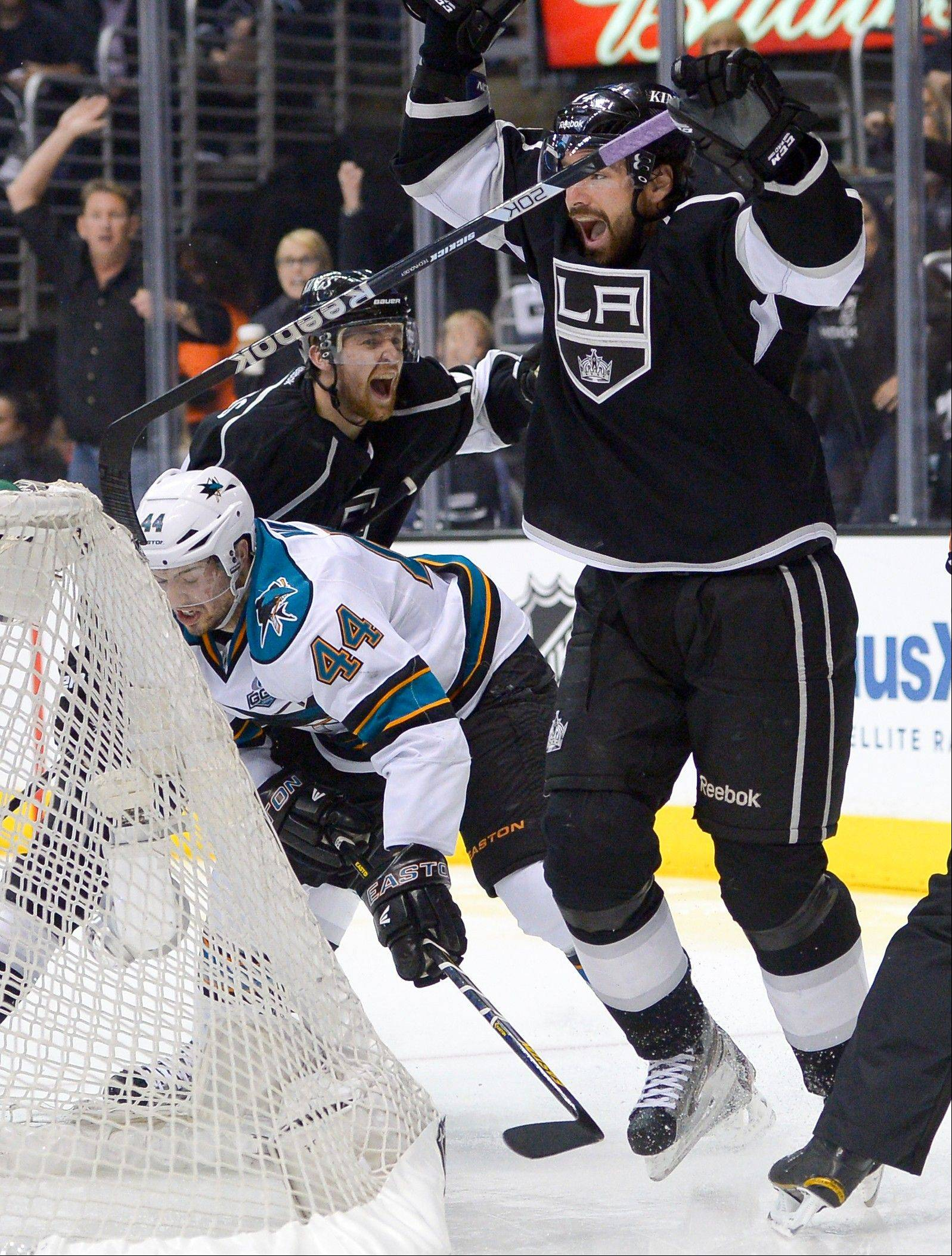 Los Angeles Kings right wing Justin Williams, right, celebrates his goal with Trevor Lewis as San Jose Sharks defenseman Marc-Edouard Vlasic, left, looks away during the second period in Game 7 of the Western Conference semifinals in the NHL hockey Stanley Cup playoffs, Tuesday, May 28, 2013, in Los Angeles. (AP Photo/Mark J. Terrill)
