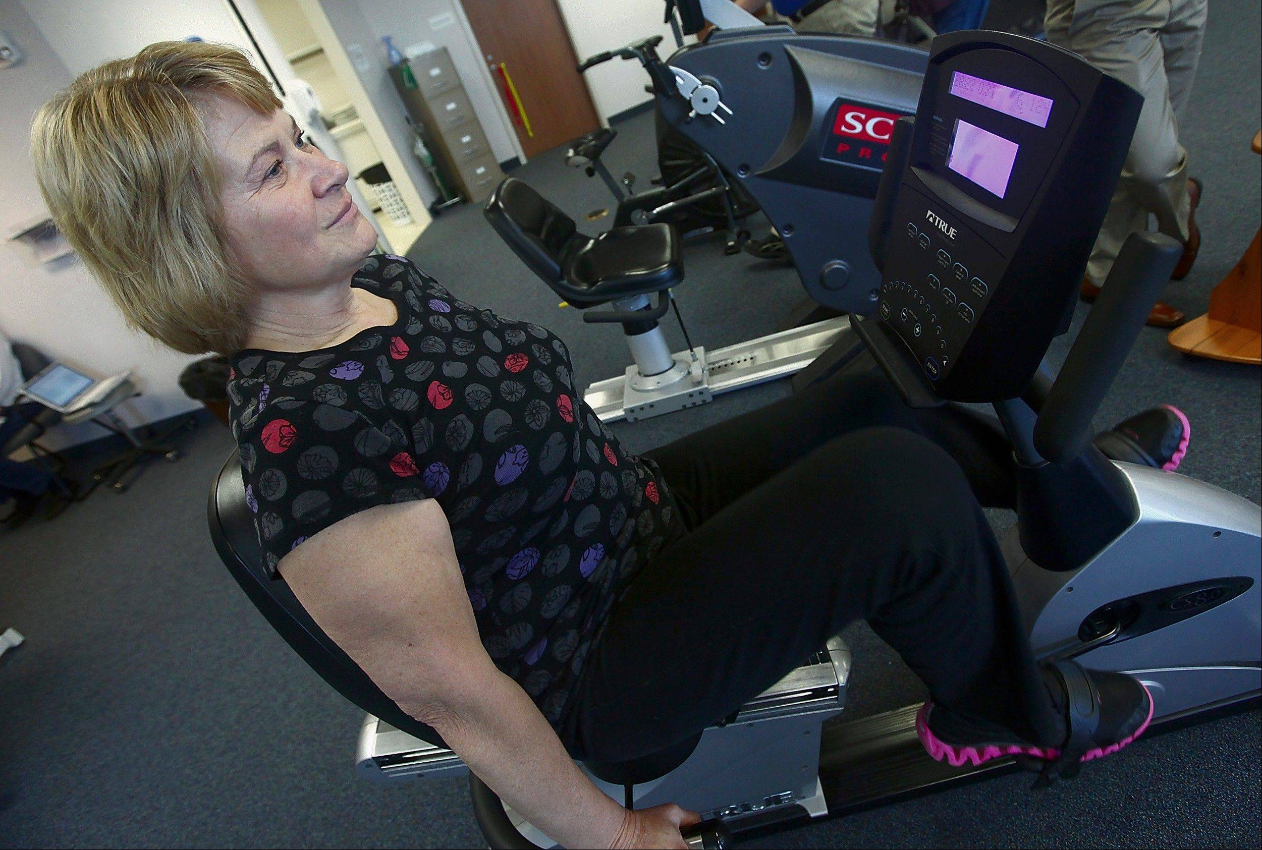 Postal carrier Nadine O'Brien, 52, who had both knees replaced six weeks ago, works out at Quincy Medical Group trying to rehab her knees to get back to her walking route with the postal service.