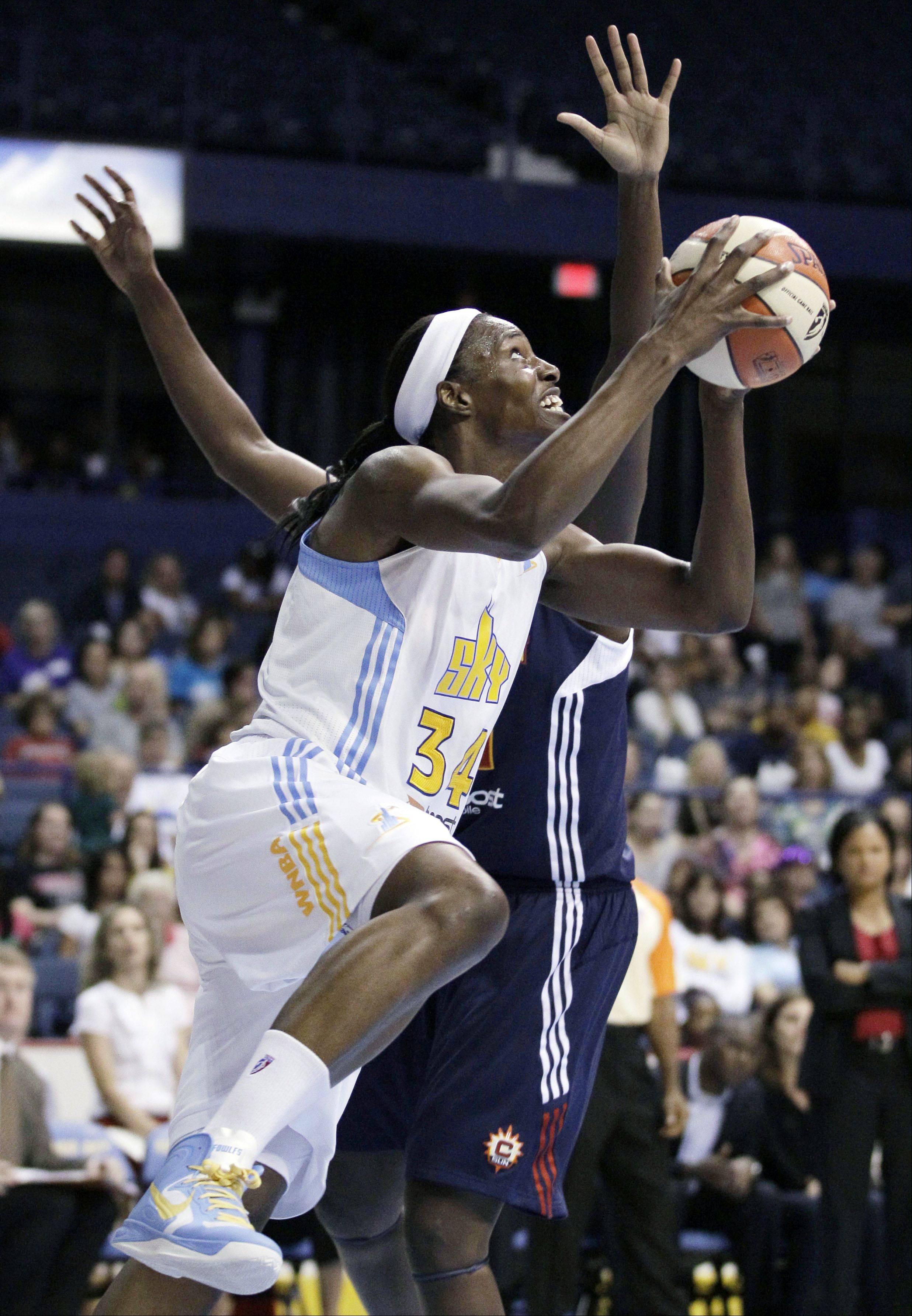 Chicago Sky center Sylvia Fowles (34) drove to the basket while Connecticut Sun center Tina Charles (31) guarded her during a WNBA basketball game last season. The Chicago Sky returns to the Allstate Arena in Rosemont this weekend.
