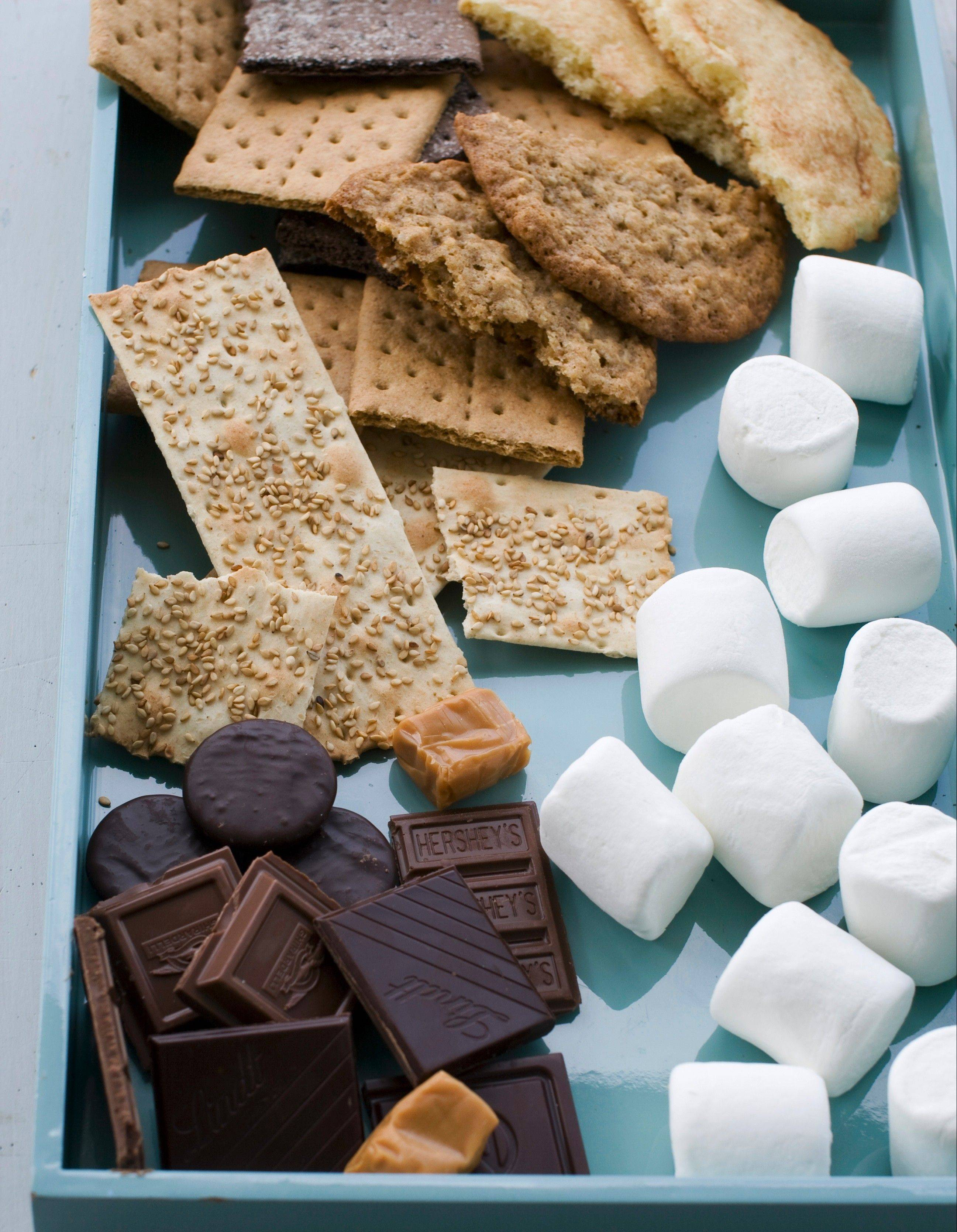 Jazz up s'mores with ingredients like flavored chocolate bars and a variety of cookies.