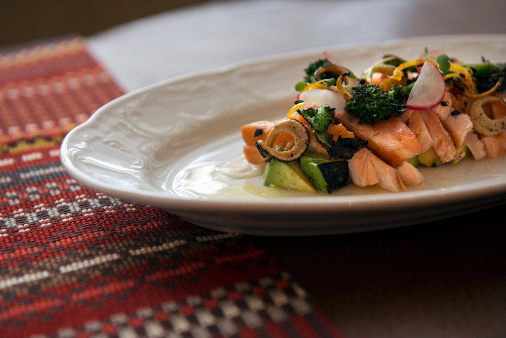 Charred Salmon Crudo with Grilled Avocado and Lemon Aioli showcases the flavors of the grill in a ceviche-style appetizer.