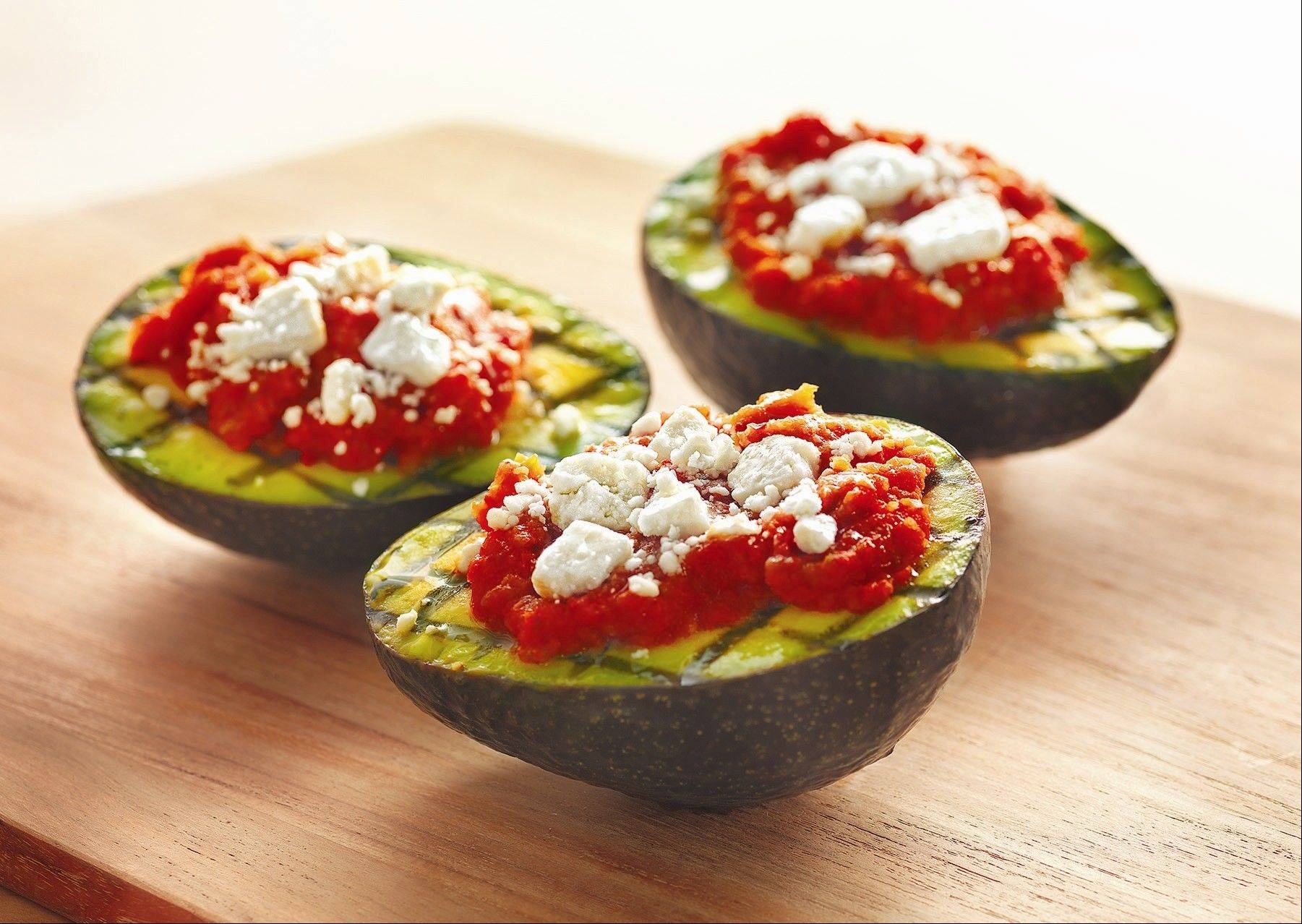 Grilled avocado halves make a refreshing serving shell for grilled vegetable relish.