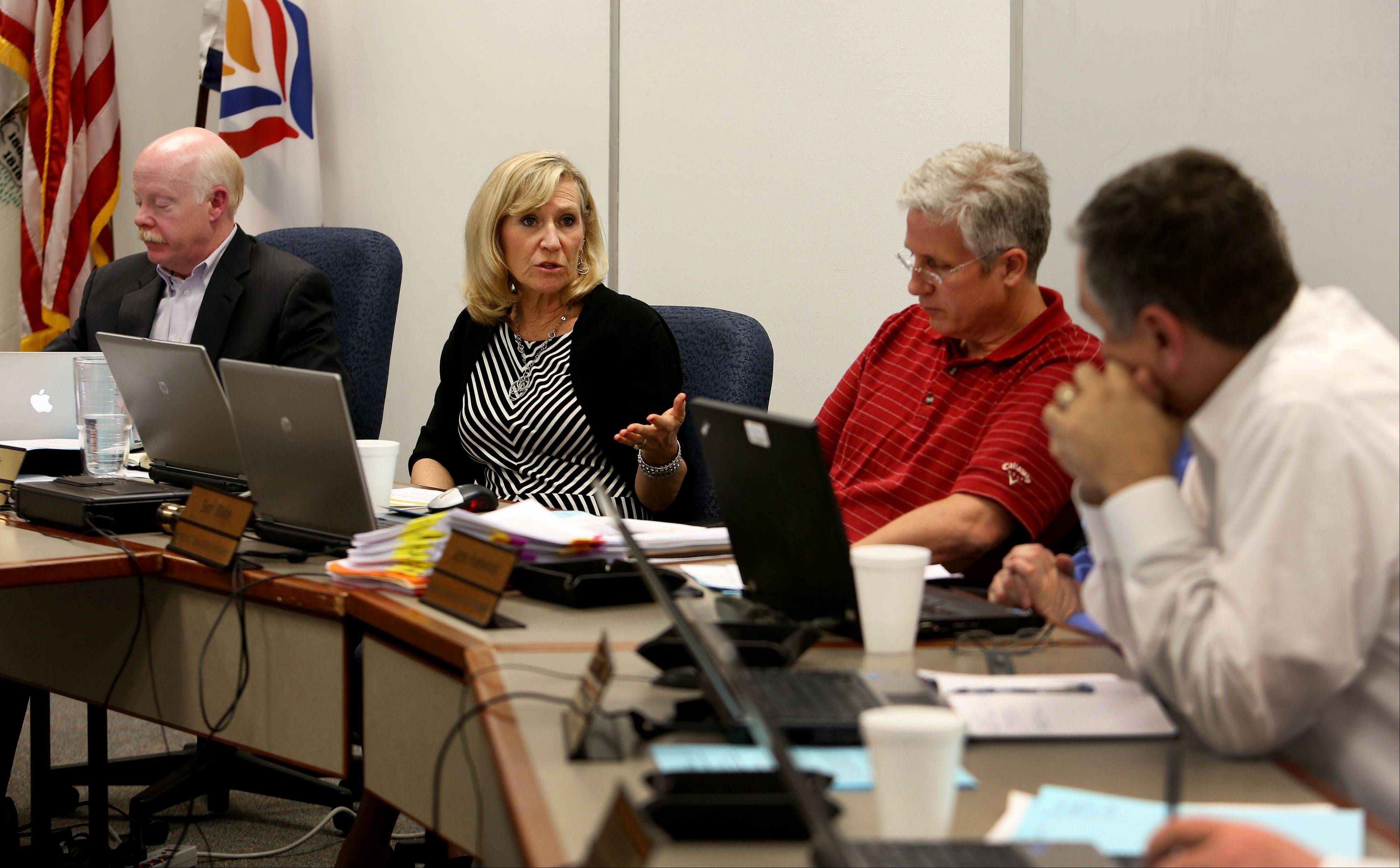 Glen Ellyn District 41 school board members listen to Superintendent Ann Riebock Tuesday during discussion of whether to reinstate a controversial book in eighth grade classrooms.